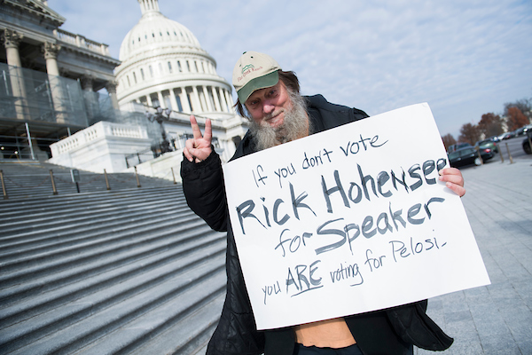 UNITED STATES - DECEMBER 13: Rick Hohensee holds a Speaker of the House themed sign at the Capitol after the last votes of the week in the House on December 13, 2018. (Photo By Tom Williams/CQ Roll Call)