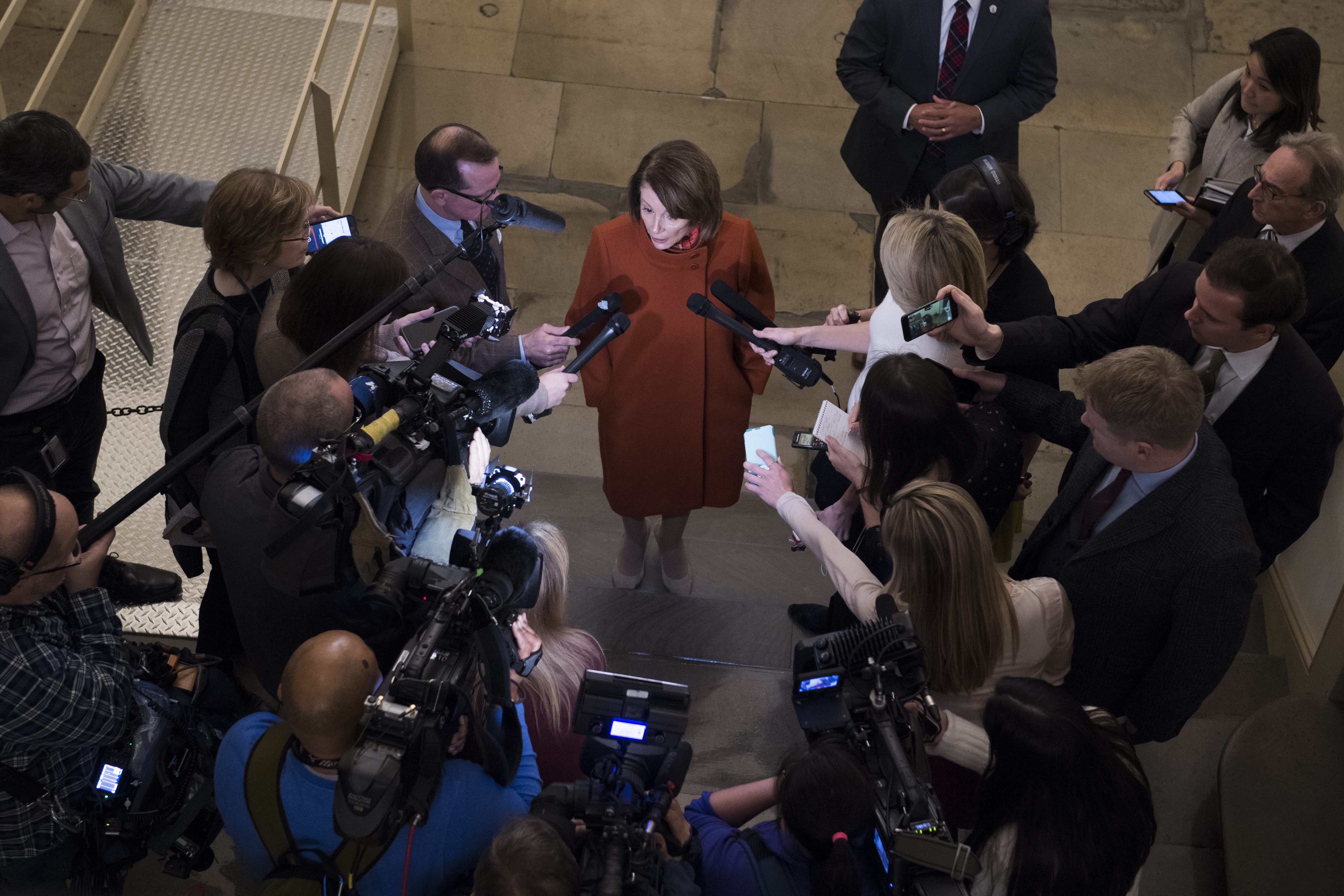 House Minority Leader Nancy Pelosi, D-Calif., talks with reporters in the Capitol after arriving back from a White House meeting with President Trump, Vice President Pence and Senate Minority Leader Charles Schumer, D-N.Y., about the border wall and a potential government shutdown on December 11, 2018.(Photo By Tom Williams/CQ Roll Call)