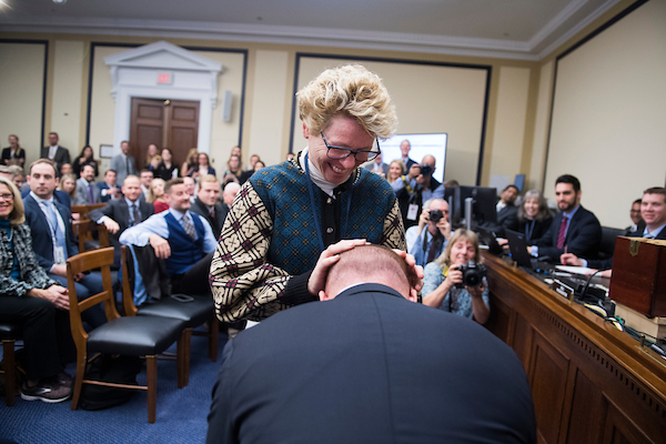 UNITED STATES - NOVEMBER 30: Rep.-elect Chrissy Houlahan, D-Pa., rubs the head of Rep.-elect Max Rose, D-N.Y., for luck, before she drew number 21, during the new member room lottery draw for office space in Rayburn Building on November 30, 2018. (Photo By Tom Williams/CQ Roll Call)