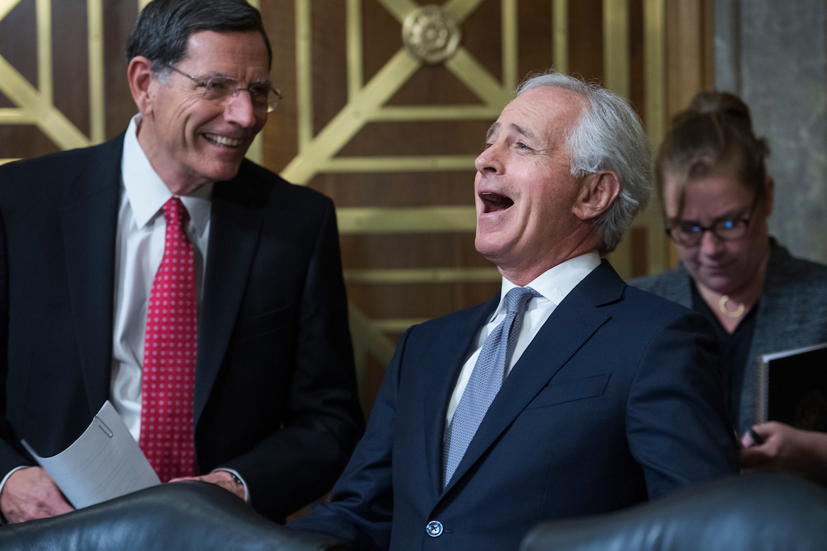 UNITED STATES - APRIL 23: Chairman Bob Corker, R-Tenn., right, and Sen. John Barrasso, R-Wyo., confer before a Senate Foreign Relations committee markup in Dirksen Building on the nomination of Mike Pompeo to be secretary of state on April 23, 2018. (Photo By Tom Williams/CQ Roll Call)