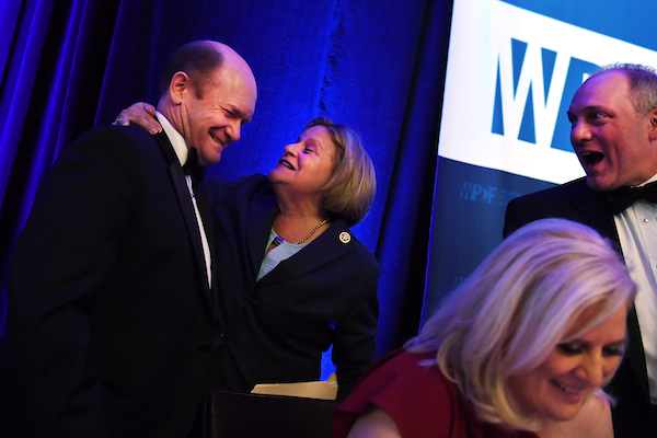 UNITED STATES - MARCH 06: Rep. Ileana Ros-Lehtinen, R-Fla., greets Sen. Chris Coons, D-Del., as House Majority Whip Steve Scalise, R-La., looks on, during the Washington Press Club Foundation's annual dinner featuring satirical roasts by lawmakers on March 06, 2018. Ros-Lehtinen and Coons were the featured acts at the event held at the Mandarin Oriental. Deirdre Walsh of CNN also appears. (Photo By Tom Williams/CQ Roll Call)