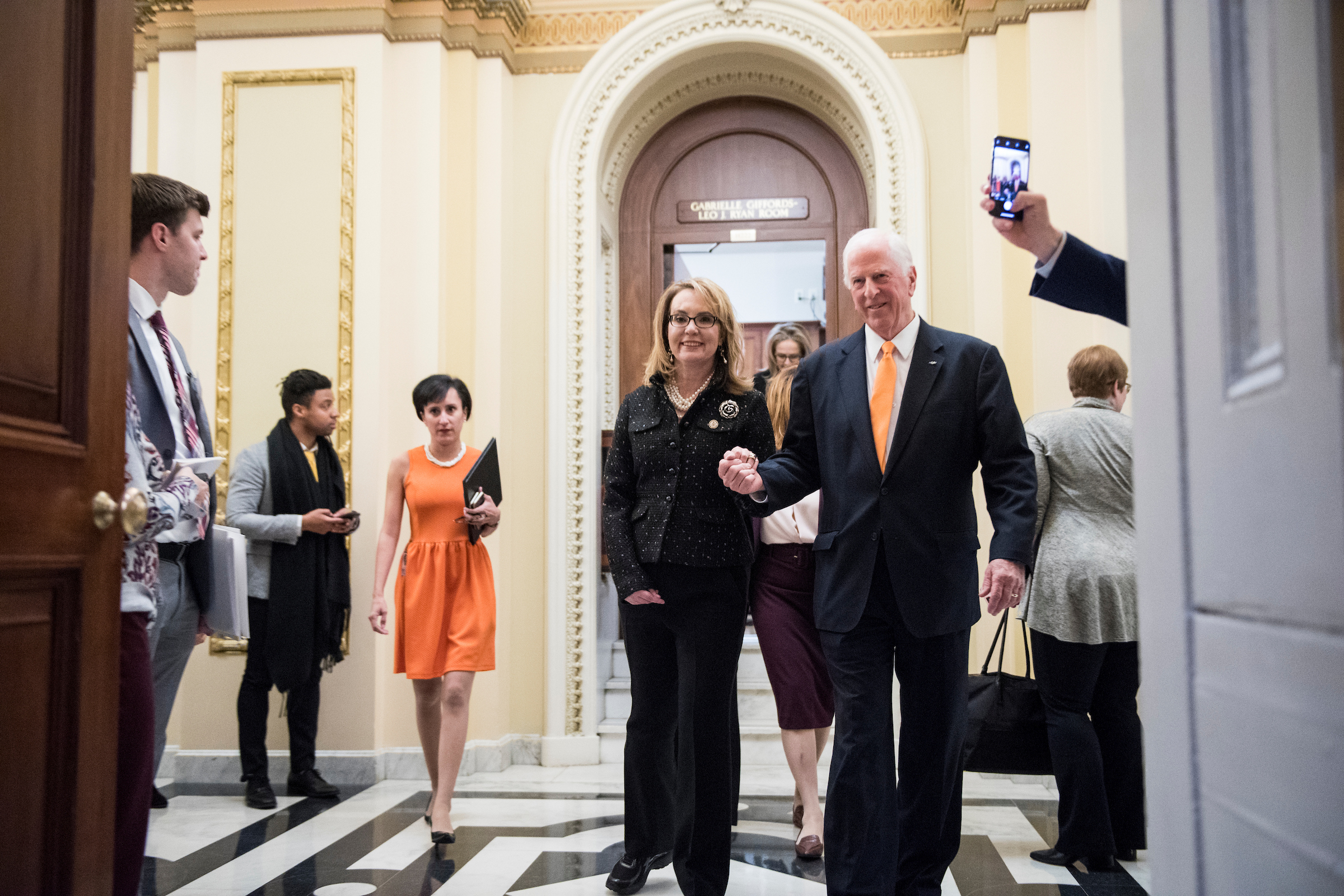 UNITED STATES - JANUARY 8: Former Rep. Gabby Giffords, D-Ariz., and Rep. Mike Thompson, D-Calif., leave the Gabrielle Giffords-Leo J. Ryan Room, after officially submitting the Bipartisan Background Checks Act of 2019 in the Capitol on Tuesday, Jan. 8, 2018. (Photo By Bill Clark/CQ Roll Call)