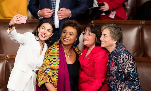 Freshman Reps. from left, Alexandria Ocasio-Cortez, D-N.Y., Barbara Lee, D-Texas, Annie Kuster, D-N.H., and Jan Schakowsky, D-Ill., take a selfie on the House floor before the start of the election of the Speaker of the House on Thursday, Jan. 3, 2019. (Bill Clark/CQ Roll Call)