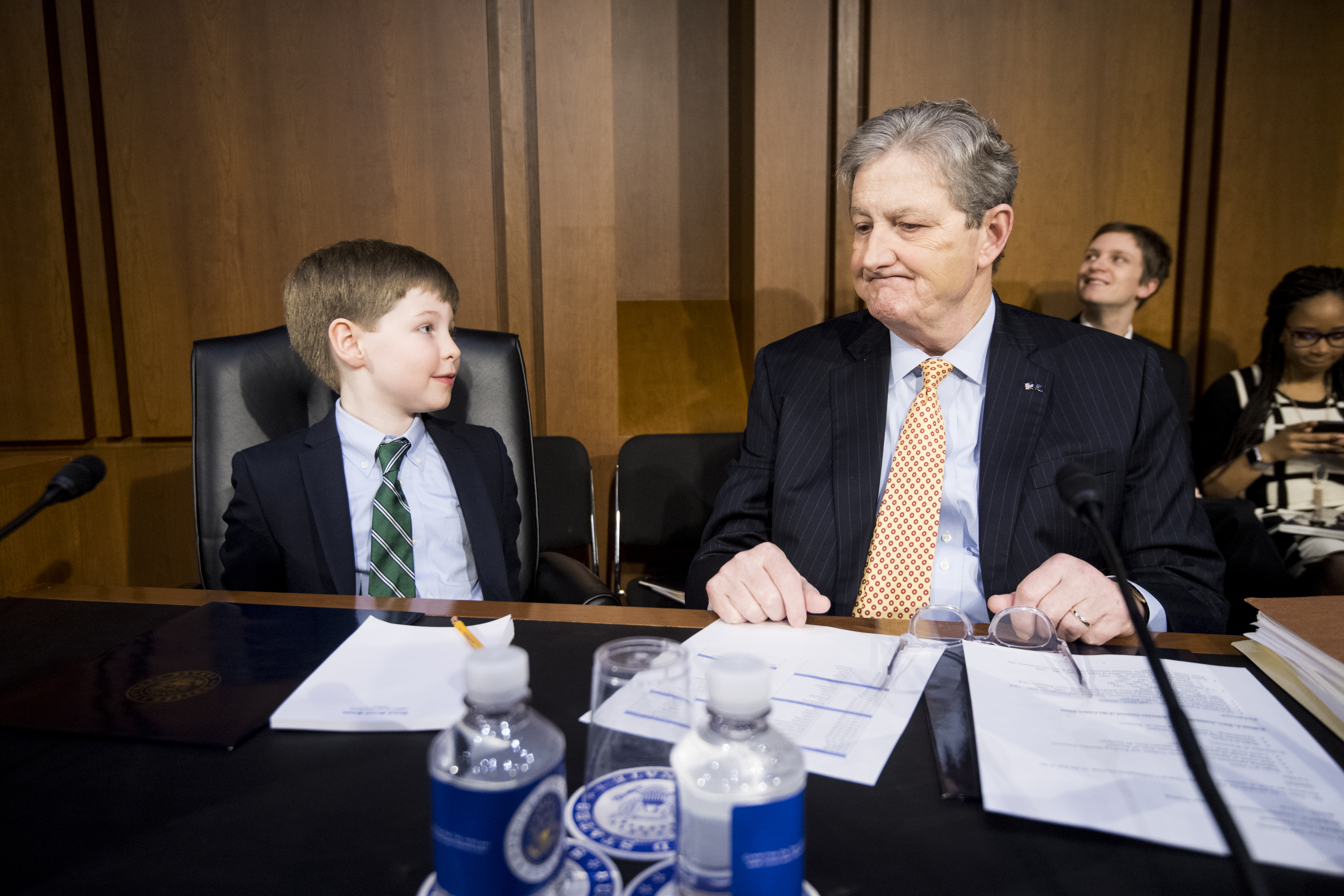 UNITED STATES - JANUARY 15: Sen. John Kennedy, R-La., chats with William Barr's grandson Liam about making snowballs and flying on Air Force One before the start of the confirmation hearing for William P. Barr, nominee to he Attorney General of the United States, in the Senate Judiciary Committee on Tuesday, Jan. 15, 2019. (Photo By Bill Clark/CQ Roll Call)