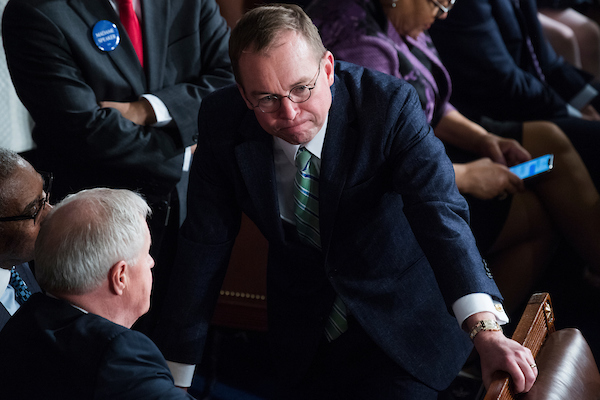 White House Chief of Staff Mick Mulvaney talks with Reps. Gregory Meeks, D-N.Y., far left, and Collin Peterson, D-Minn., in the Capitol's House chamber before members were sworn in on the first day of the 116th Congress on January 3, 2019. (Tom Williams/CQ Roll Call)