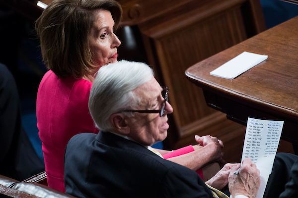 Speaker of the House Nancy Pelosi, D-Calif., and House Majority Leader Steny Hoyer, D-Md., tally votes before she won the speakership in the Capitol's House chamber on the first day of the 116th Congress on January 3, 2019. (Tom Williams/CQ Roll Call)
