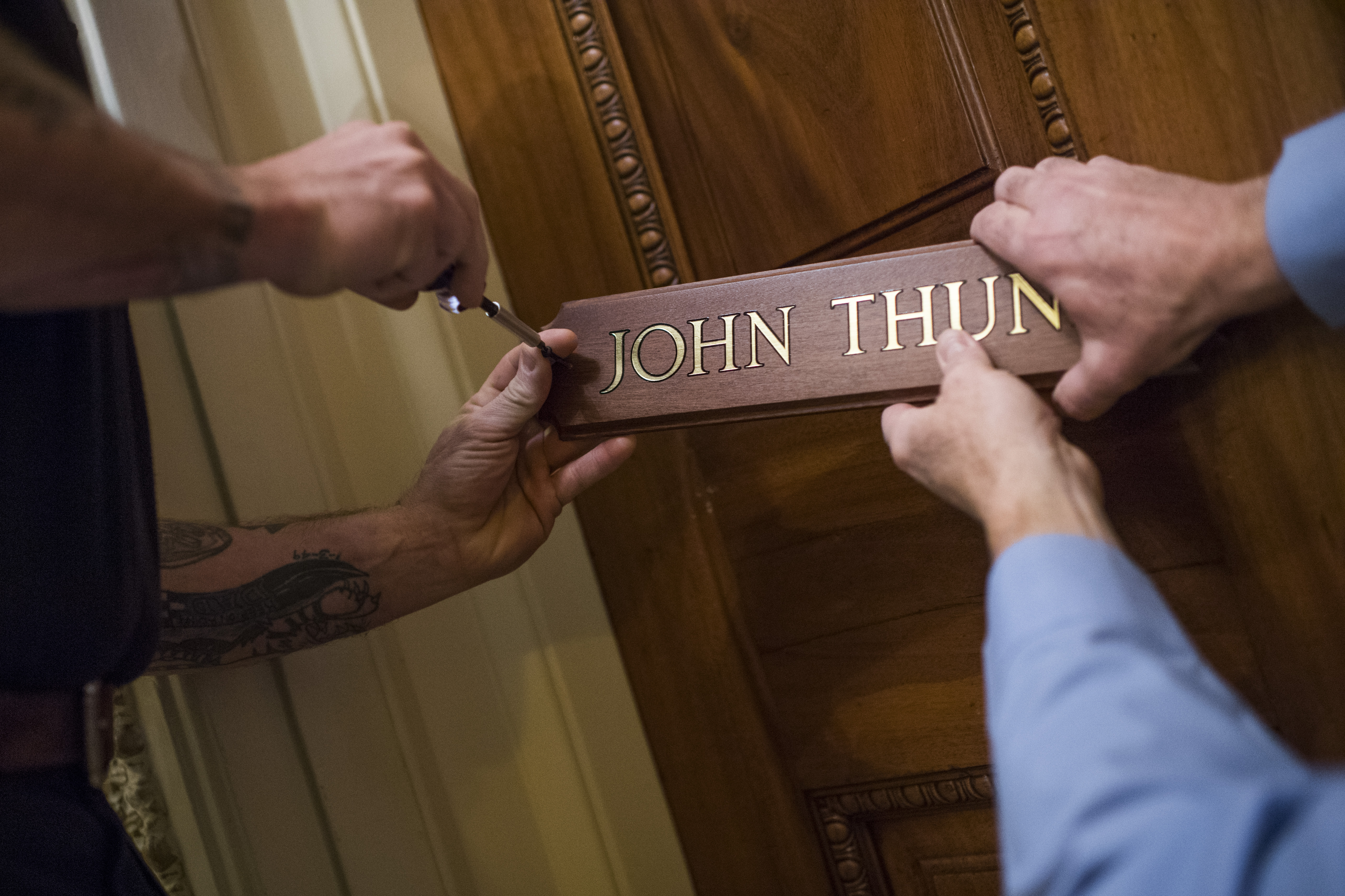 UNITED STATES - JANUARY 14: Workers install the name plate of new Senate Majority Whip John Thune, R-S.D., on his Capitol office that was occupied by the former whip Sen. John Cornyn, R-Texas, on January 14, 2019. (Photo By Tom Williams/CQ Roll Call)