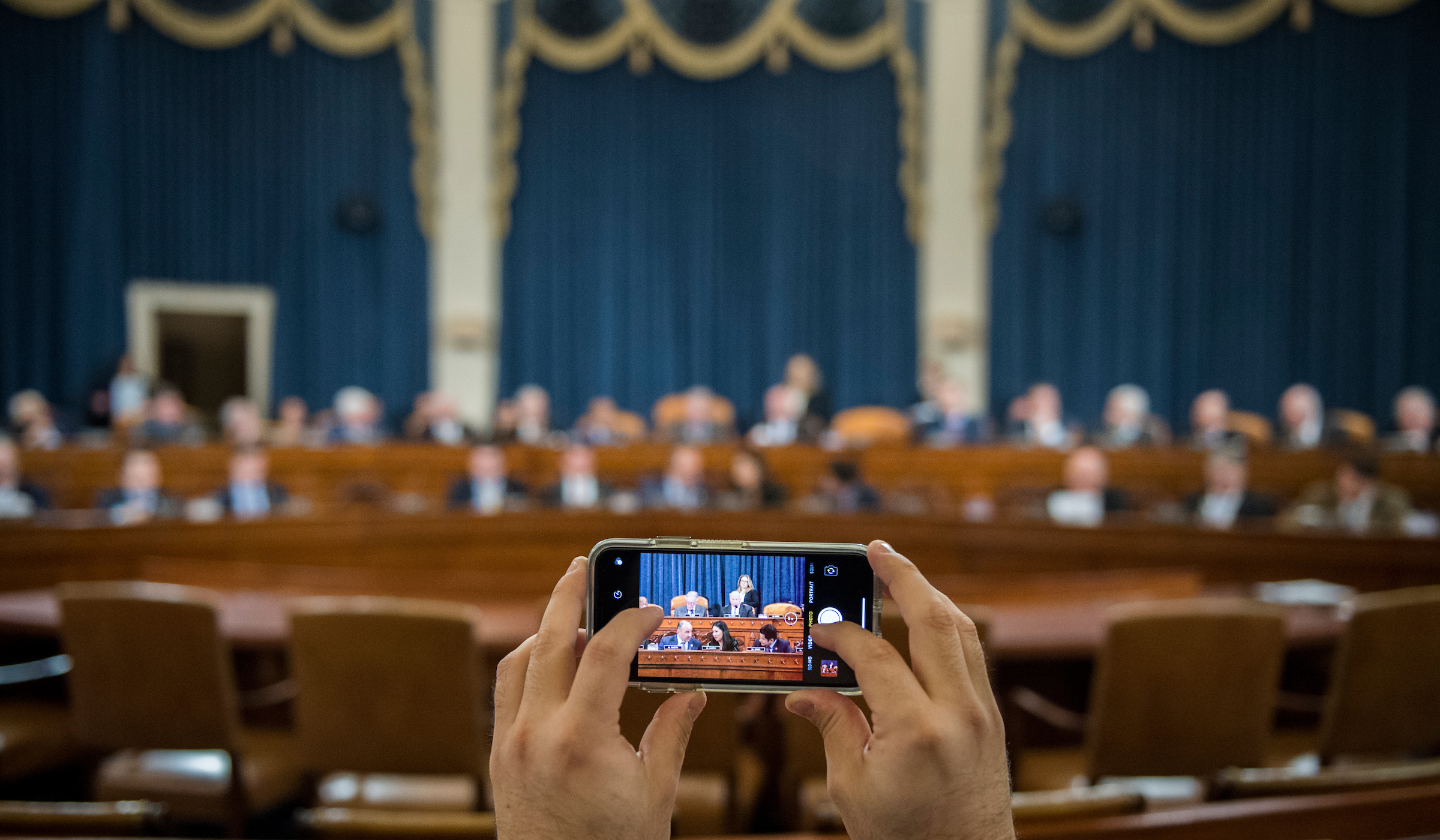A House staffer takes photos as the House Ways and Means Committee holds its organizational meeting for the 166th Congress on Thursday, Jan. 24, 2019. (Bill Clark/CQ Roll Call)