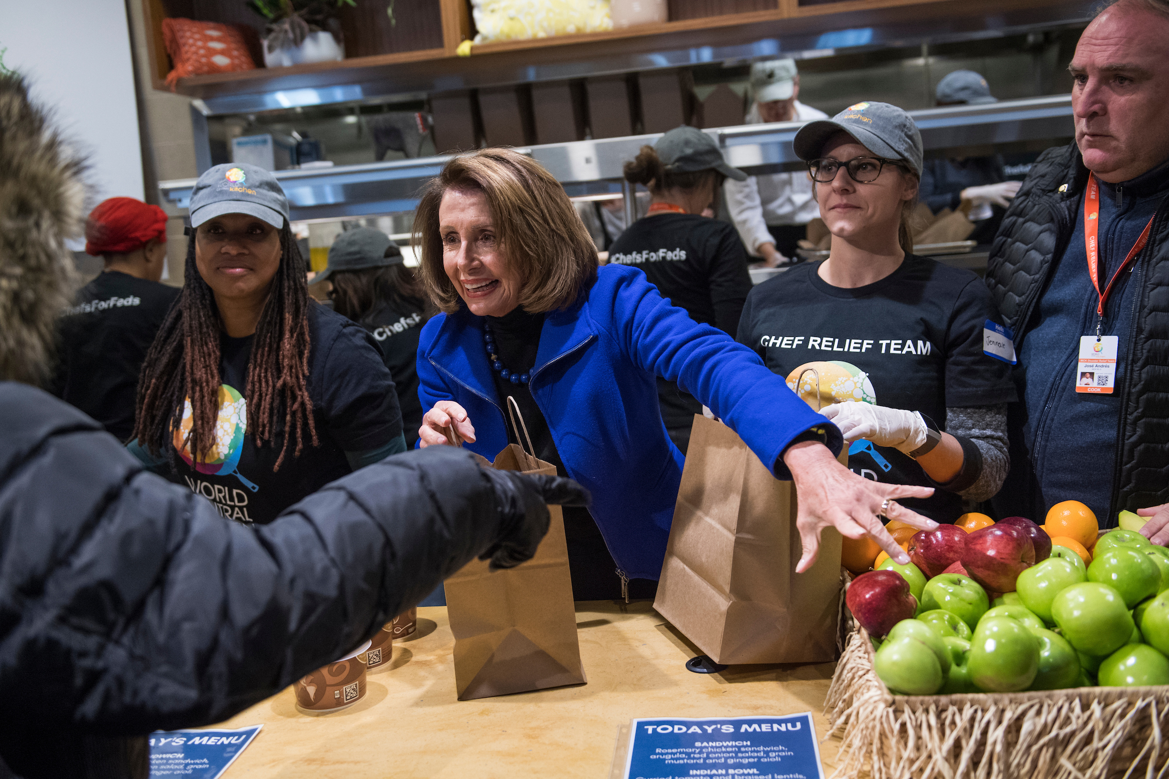 Speaker Nancy Pelosi, D-Calif., and chef Jose Andres, right, serve free meals to federal workers who have been affected by the partial government shutdown at Andres' World Central Kitchen in downtown Washington on Tuesday, Jan. 22, 2019. (Tom Williams/CQ Roll Call)