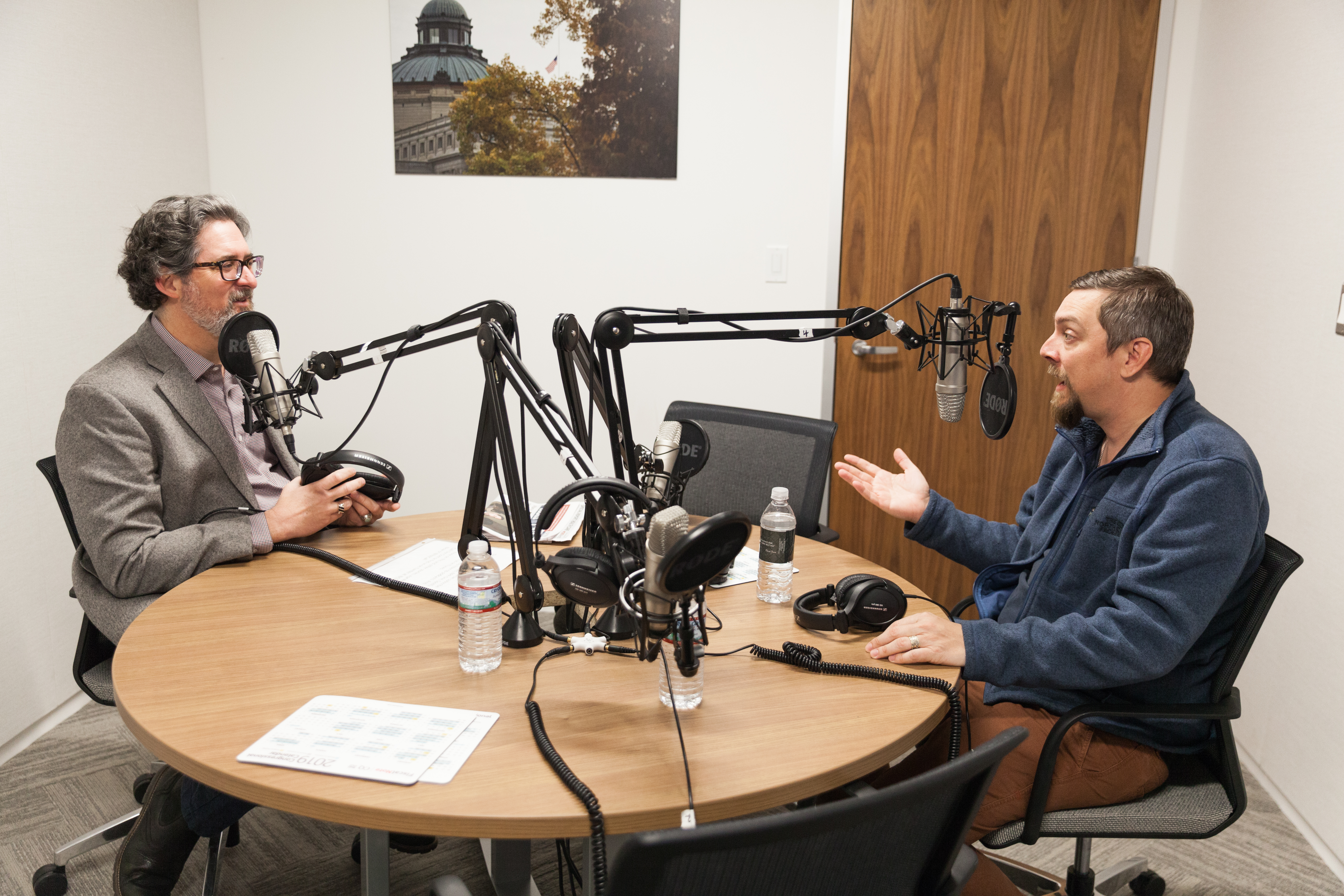 """Apollo 11"" director Todd Douglas Miller, right, discusses his documentary about the iconic moon landing with Political Theater Podcast host Jason Dick. (Nathan Ouellette/CQ Roll Call)"