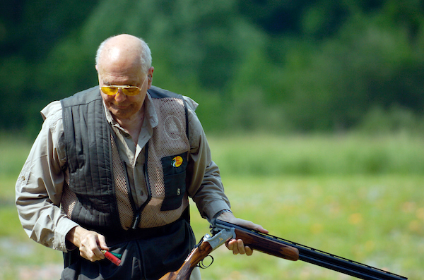 John Dingell get set up on the skeet range during the 10th Annual Great Congressional Shoot-Out at Prince George's Shooting Center in Glenn Dale, Maryland.