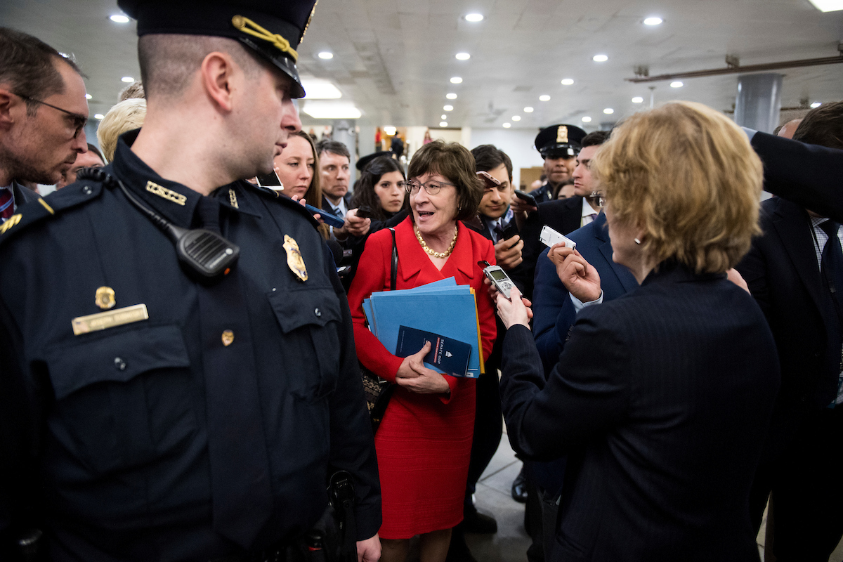 Multiple Capitol Police officers flanked Sen. Susan Collins, R-Me., Thursday. (Bill Clark/CQ Roll Call)