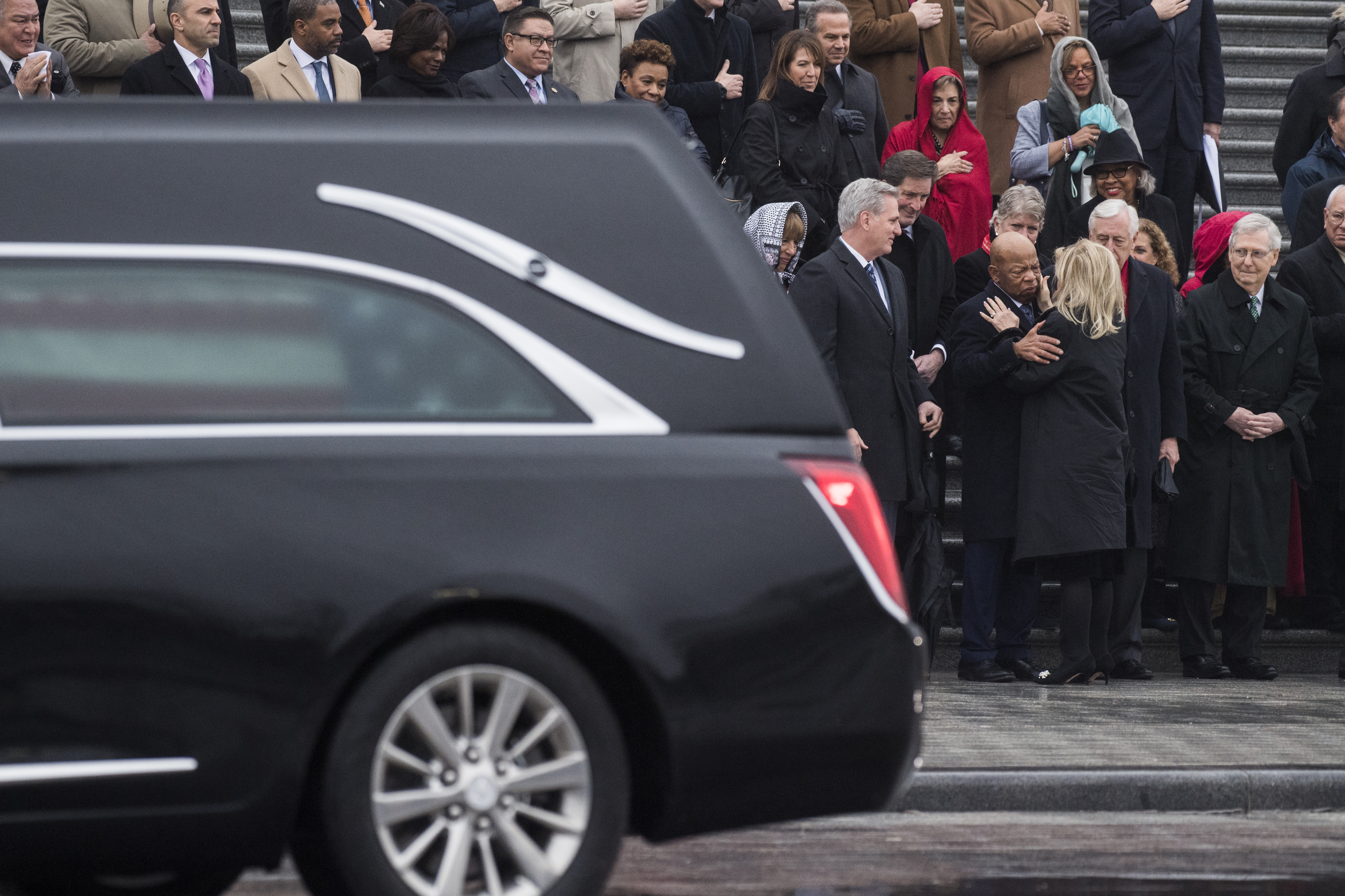UNITED STATES - FEBRUARY 12: Rep. John Lewis, D-Ga., greets Rep. Debbie Dingell, D-Mich., wife of the late Rep. John Dingell, D-Mich., as members pay respects to Dingell as the hearse containing his casket stops at the House Steps on the East Front of the Capitol on Tuesday, February 12, 2019. (Photo By Tom Williams/CQ Roll Call)
