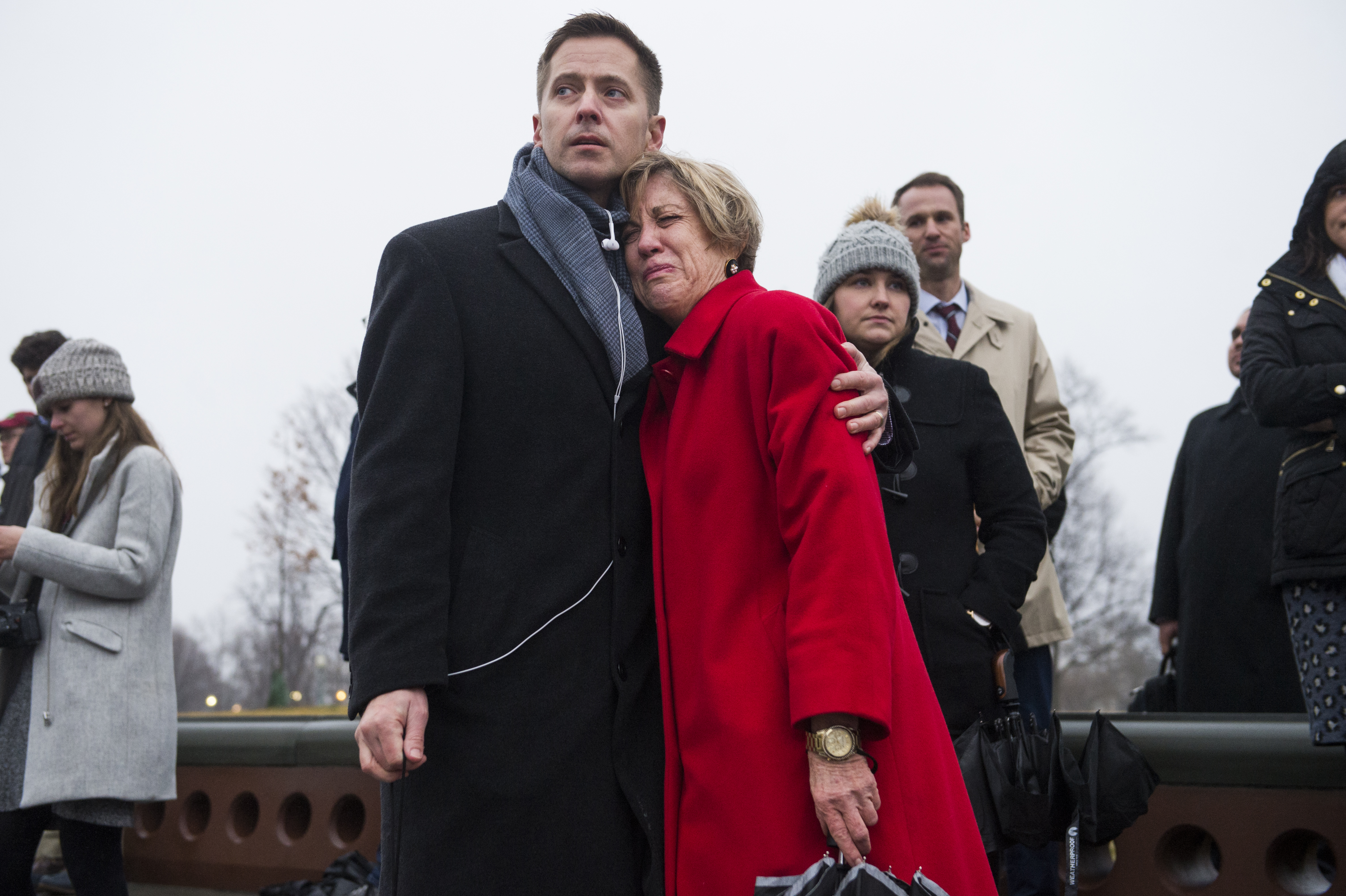 UNITED STATES - FEBRUARY 12: Bridgett Taylor and Pete Filon, former aides to the late Rep. John Dingell, D-Mich., look on, as members pay respects to Dingell as the hearse containing his casket stops at the House Steps on the East Front of the Capitol on Tuesday, February 12, 2019. (Photo By Tom Williams/CQ Roll Call)