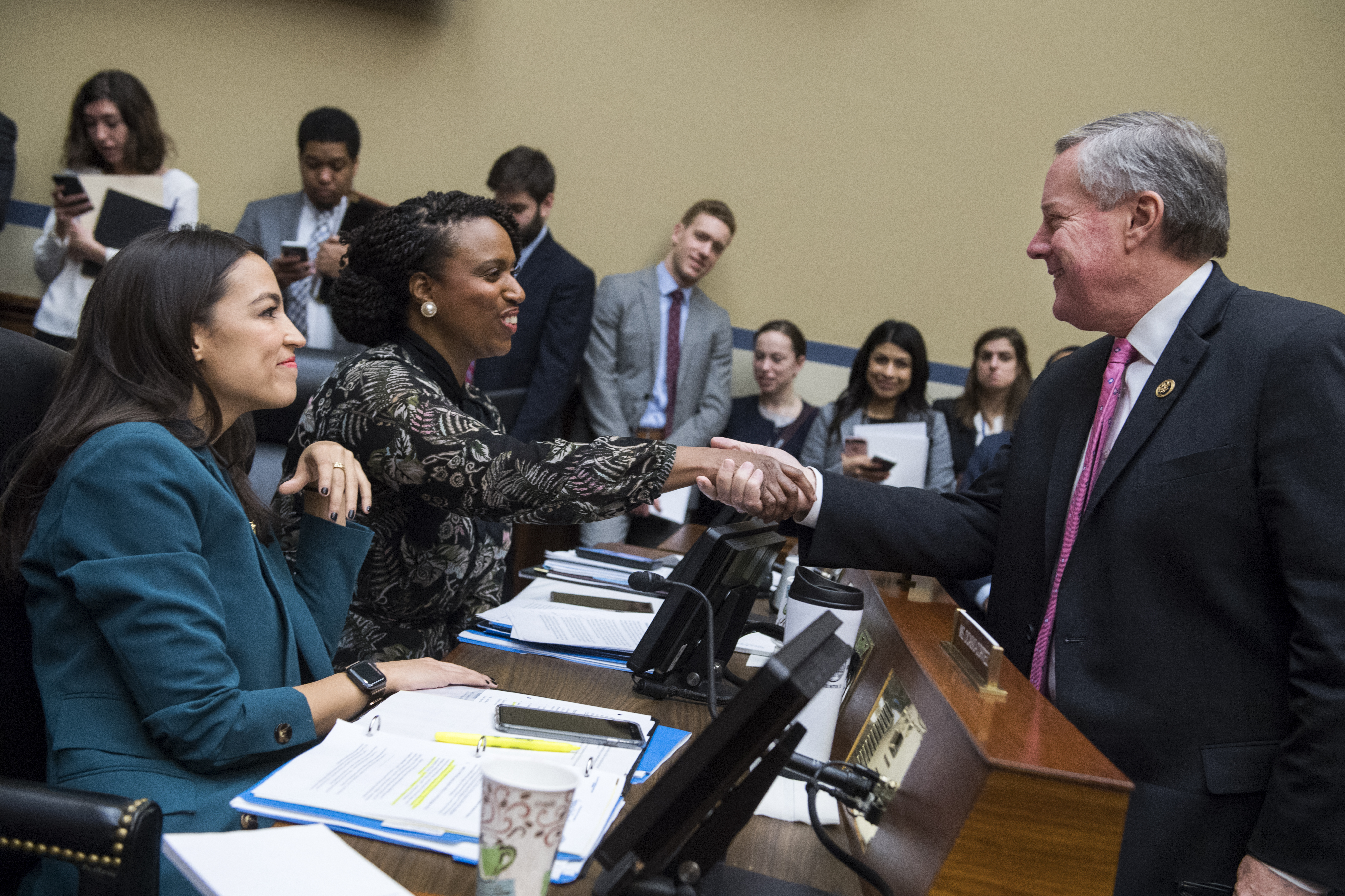 UNITED STATES - JANUARY 29: From left, Reps. Alexandria Ocasio-Cortez, D-N.Y., Ayanna Pressley, D-Mass., and Mark Meadows, R-N.C., talk during a House Oversight and Reform Committee business meeting in Rayburn Building on Tuesday, January 29, 2019. (Photo By Tom Williams/CQ Roll Call)