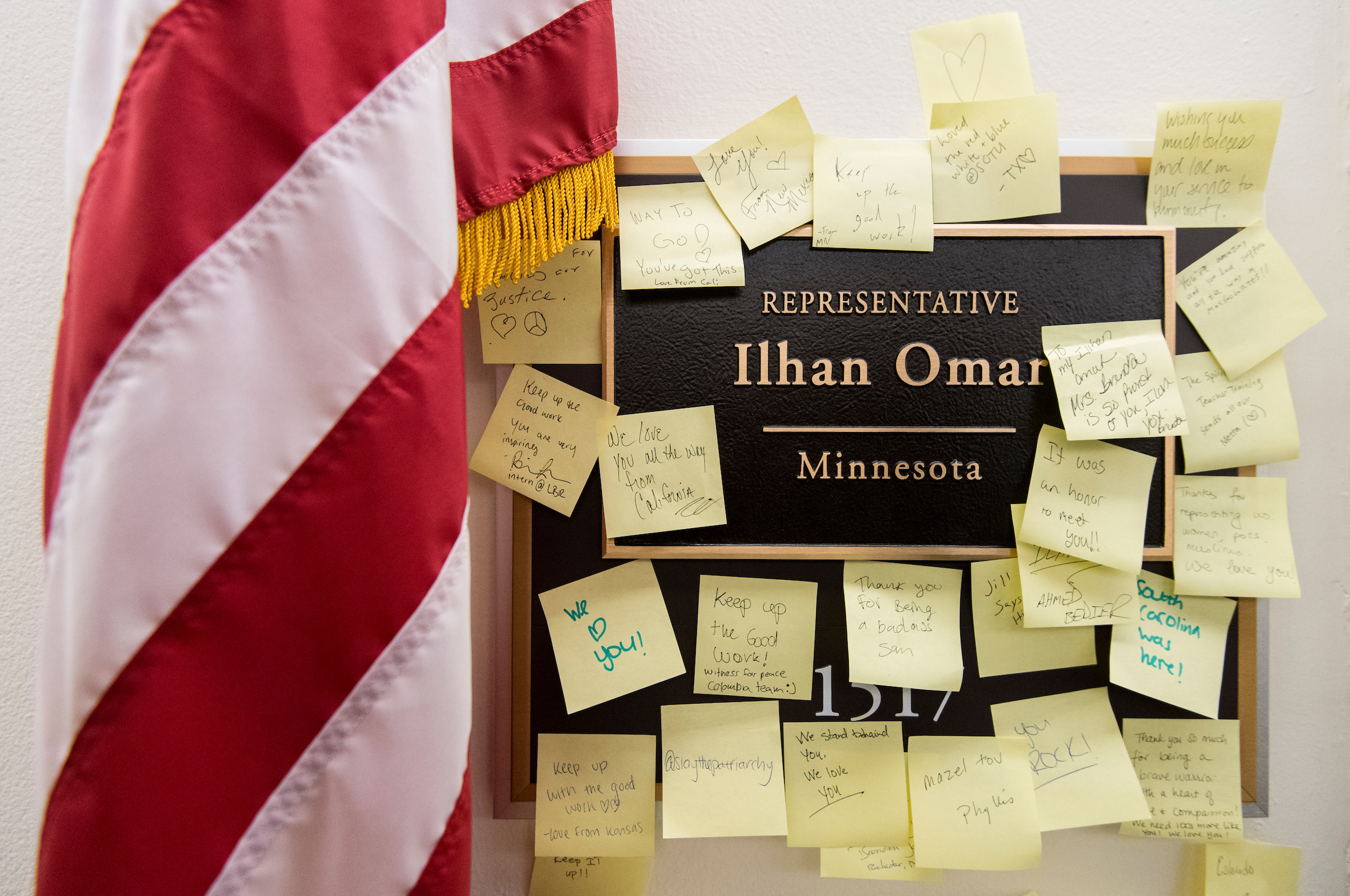 Post-It Notes with words of support are posted on the nameplate for Rep. Ilhan Omar, D-Minn., outside her office in the Longworth House Office Building on Monday, Feb. 11, 2019. (Bill Clark/CQ Roll Call)