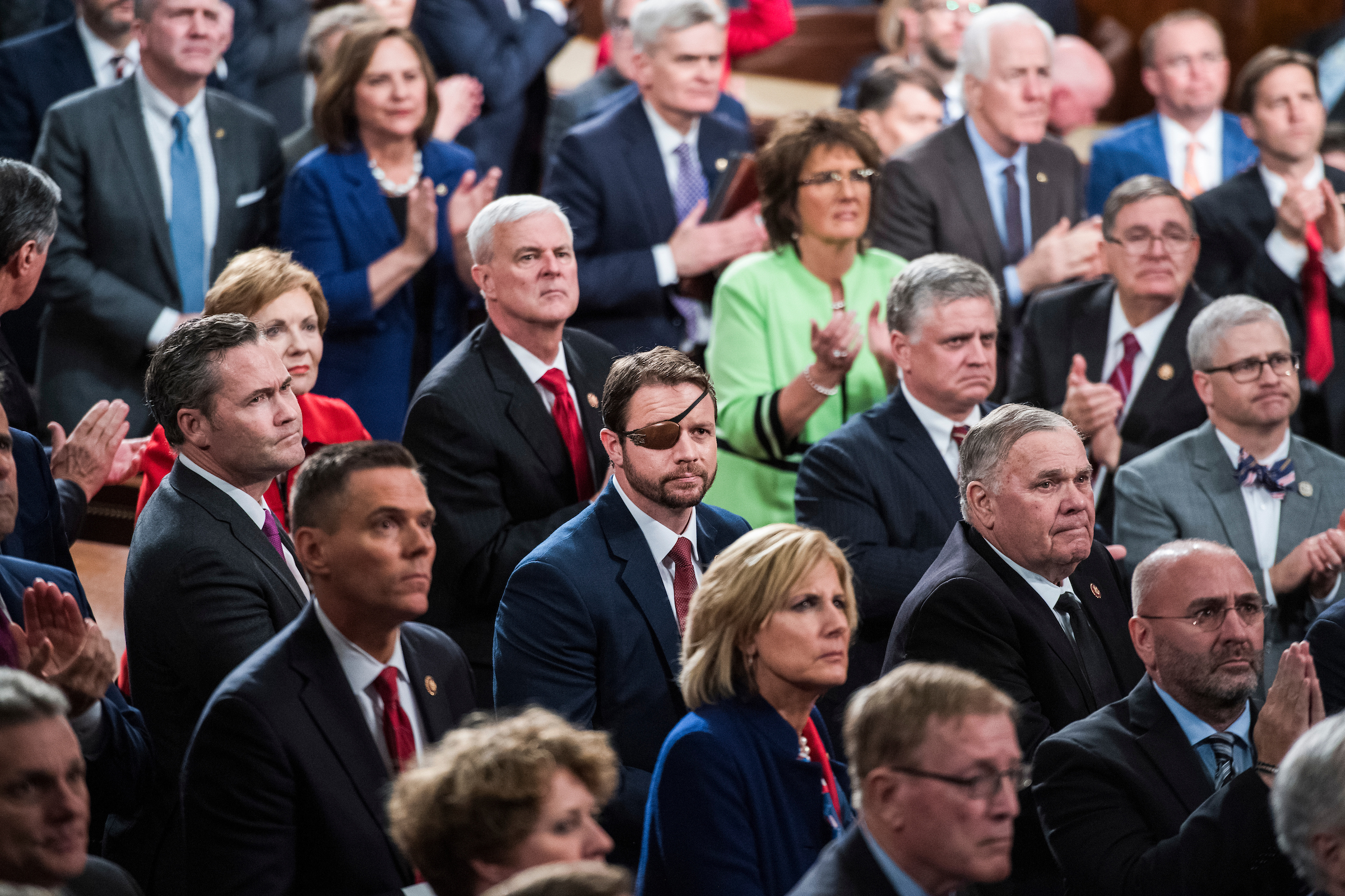 Rep. Dan Crenshaw, R-Texas, center, and House Republicans are seen in the House Chamber as President Donald Trump delivered his State of the Union address on Tuesday, February 5, 2019. (Tom Williams/CQ Roll Call)