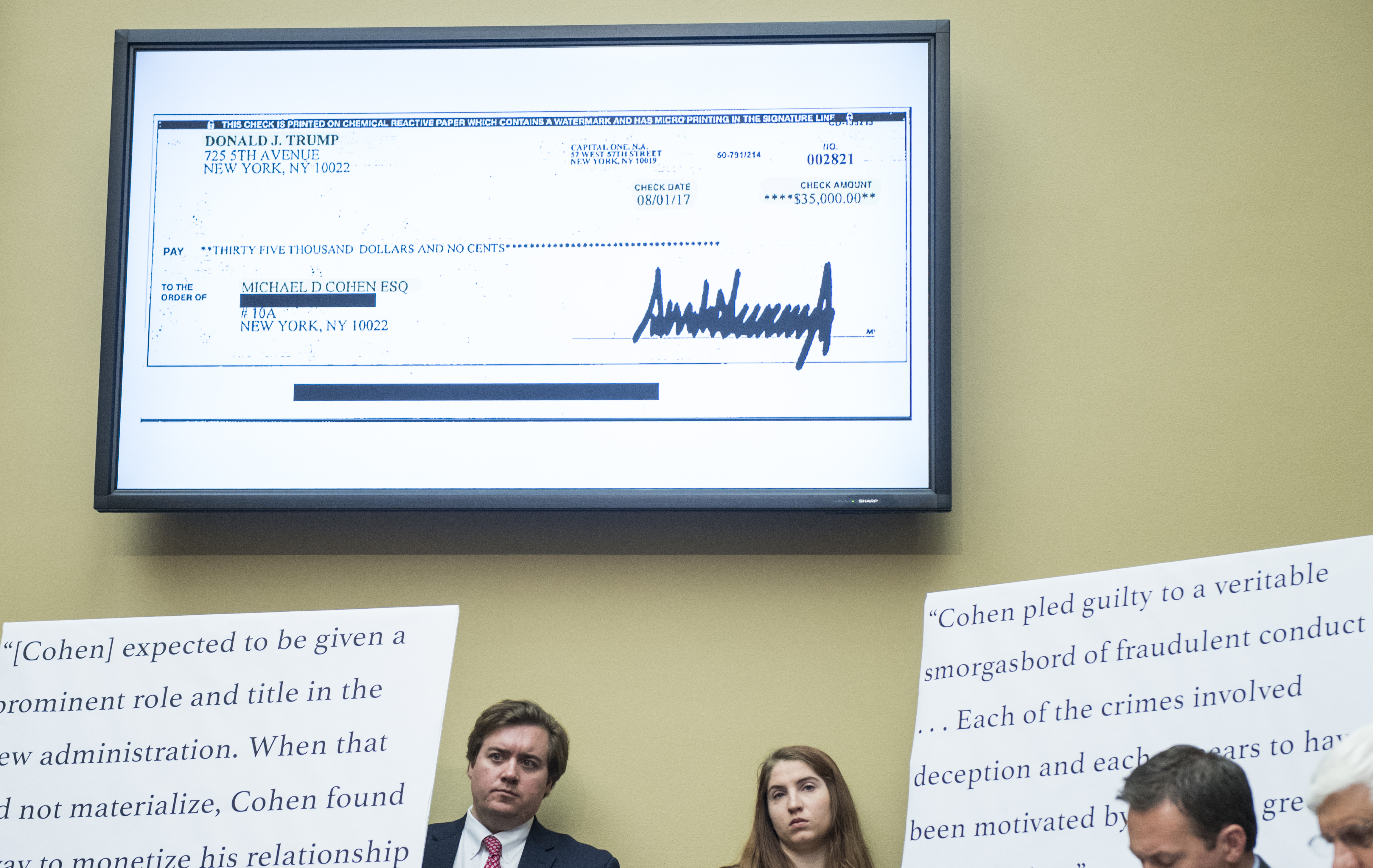 UNITED STATES - FEBRUARY 27: A check payable from President Donald Trump to Michael Cohen, former attorney for President Donald Trump, is displayed in the hearing room as Cohen testifyies during the House Oversight and Reform Committee hearing on Russian interference in the 2016 election on Wednesday, Feb. 27, 2019. (Photo By Bill Clark/CQ Roll Call)