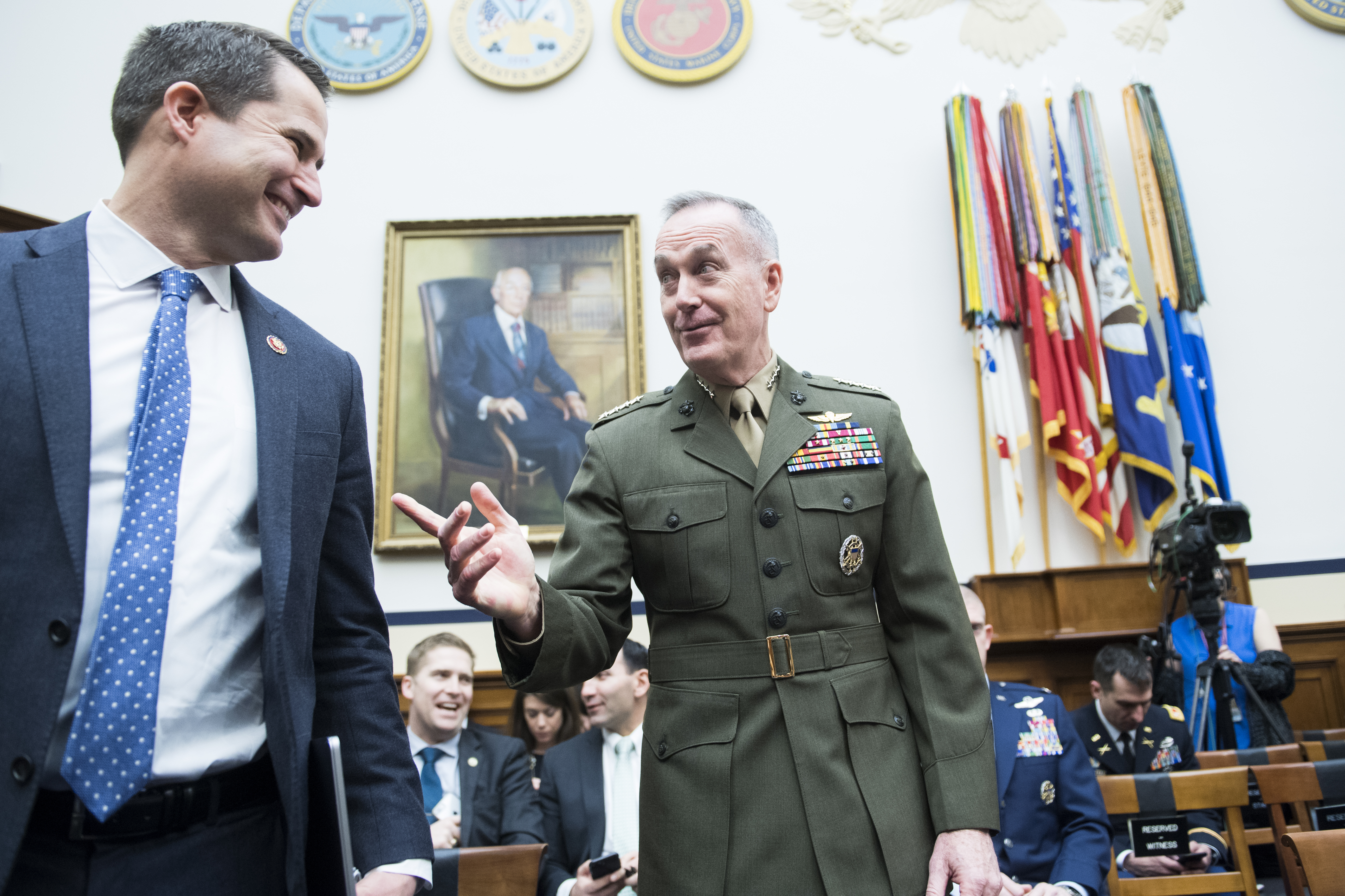 "UNITED STATES - MARCH 26: Gen. Joseph F. Dunford, chairman of the Joint Chiefs of Staff, and Rep. Seth Moulton, D-Mass., talk before a House Armed Services Committee hearing in Rayburn Building titled the ""Fiscal Year 2020 National Defense Budget Request from the Department of Defense,"" on Tuesday, March 26, 2019. (Photo By Tom Williams/CQ Roll Call)"