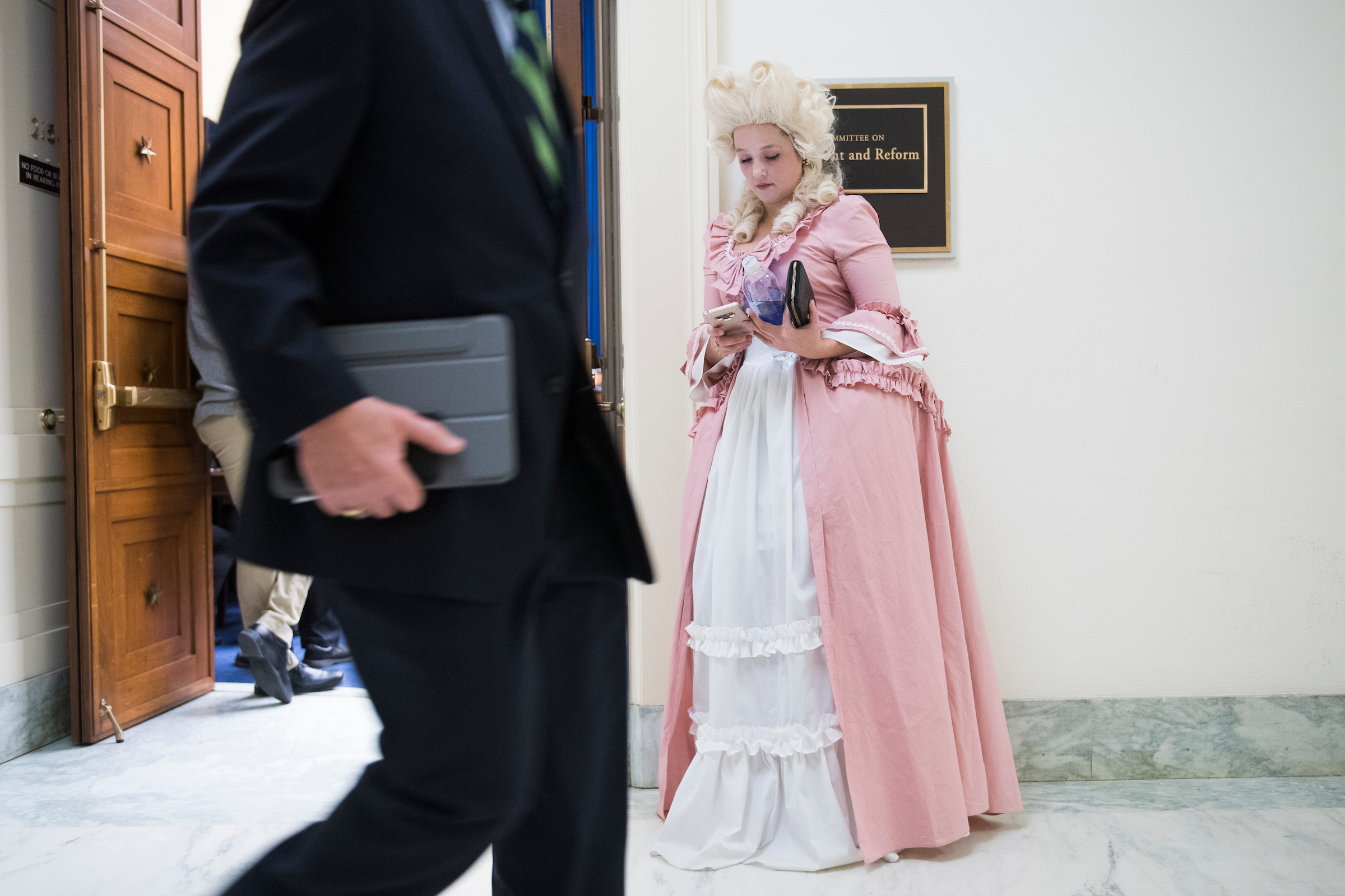 UNITED STATES - MARCH 14: Lauren Windsor of American Family Voices, dressed as Marie Antoinette, is seen outside a House Oversight and Reform Committee hearing in Rayburn Building where Commerce Secretary Wilbur Ross testified on preparations for the 2020 Census and citizenship questions on Thursday March 14, 2019. She dressed as Antoinette to highlight Ross's wealth. (Photo By Tom Williams/CQ Roll Call)