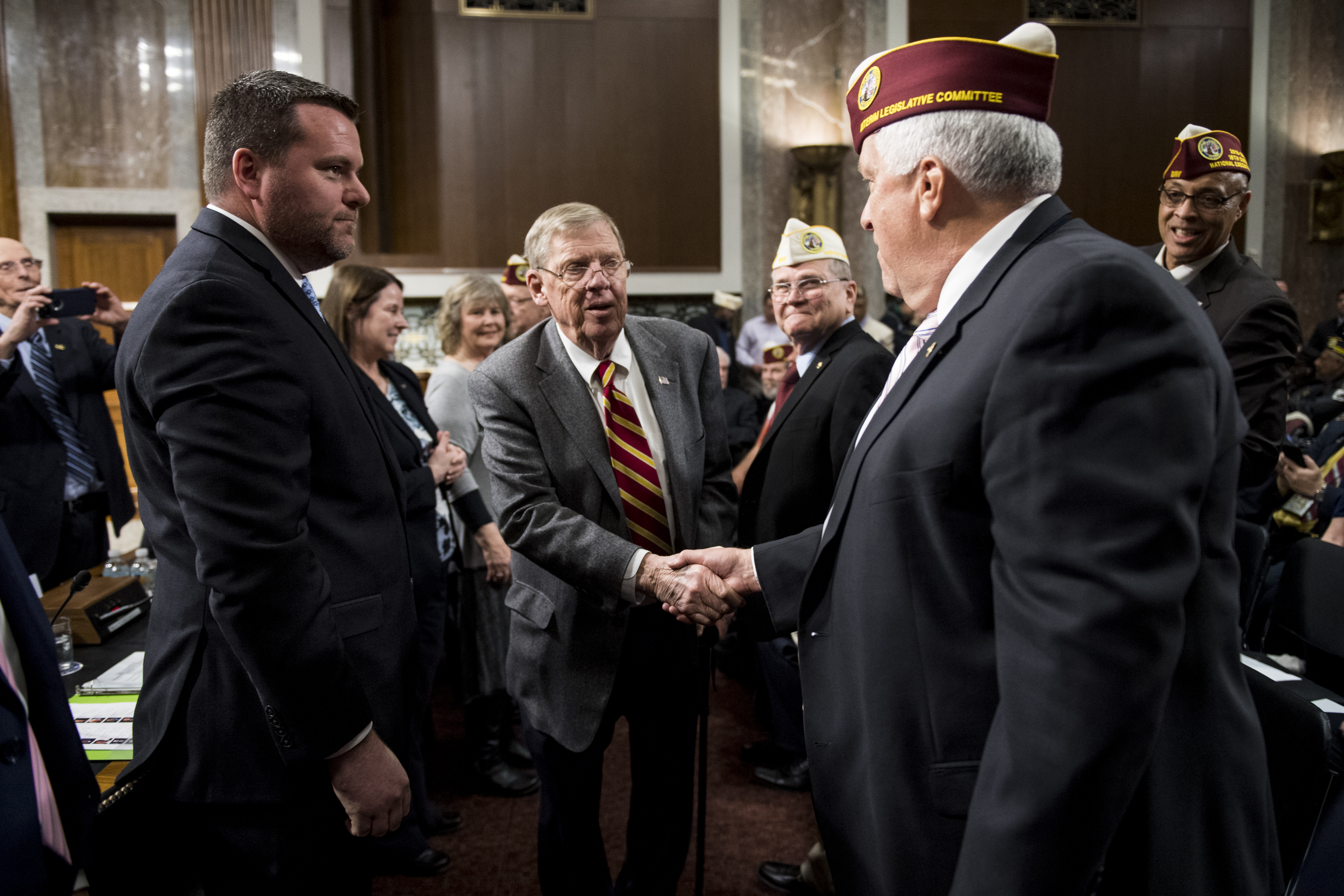 UNITED STATES - FEBRUARY 26: Chairman Johnny Isakson, R-Ga., shakes hands with members of the Disabled American Veterans as he arrives for the Joint Hearing of the House and Senate Veterans' Affairs Committees to receive the legislative presentation of the Disabled American Veterans on Tuesday, Feb. 26, 2019. (Photo By Bill Clark/CQ Roll Call)