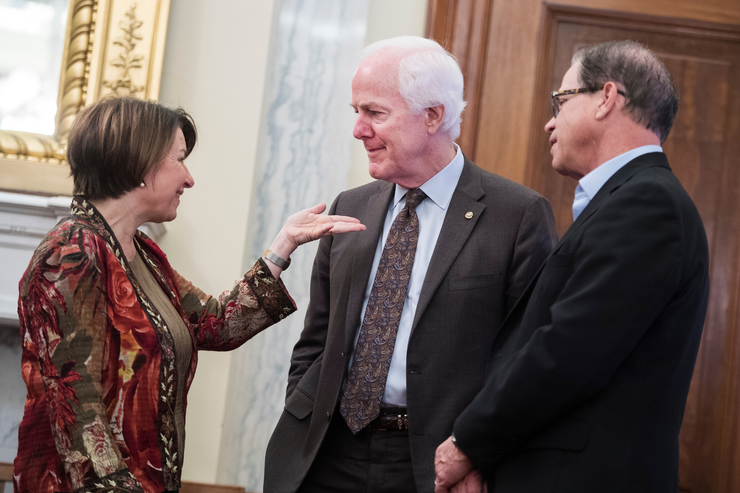 UNITED STATES - MARCH 13: From left, Sens. Amy Klobuchar, D-Minn., John Cornyn, R-Texas, and Mike Braun, R-Ind., attend a Senate Agriculture, Nutrition and Forestry Committee confirmation hearing in Russell Building on Wednesday, March 13, 2019. Heath Tarbert, nominee to be chairman of the Commodity Futures Trading Commission, testified. (Photo By Tom Williams/CQ Roll Call)