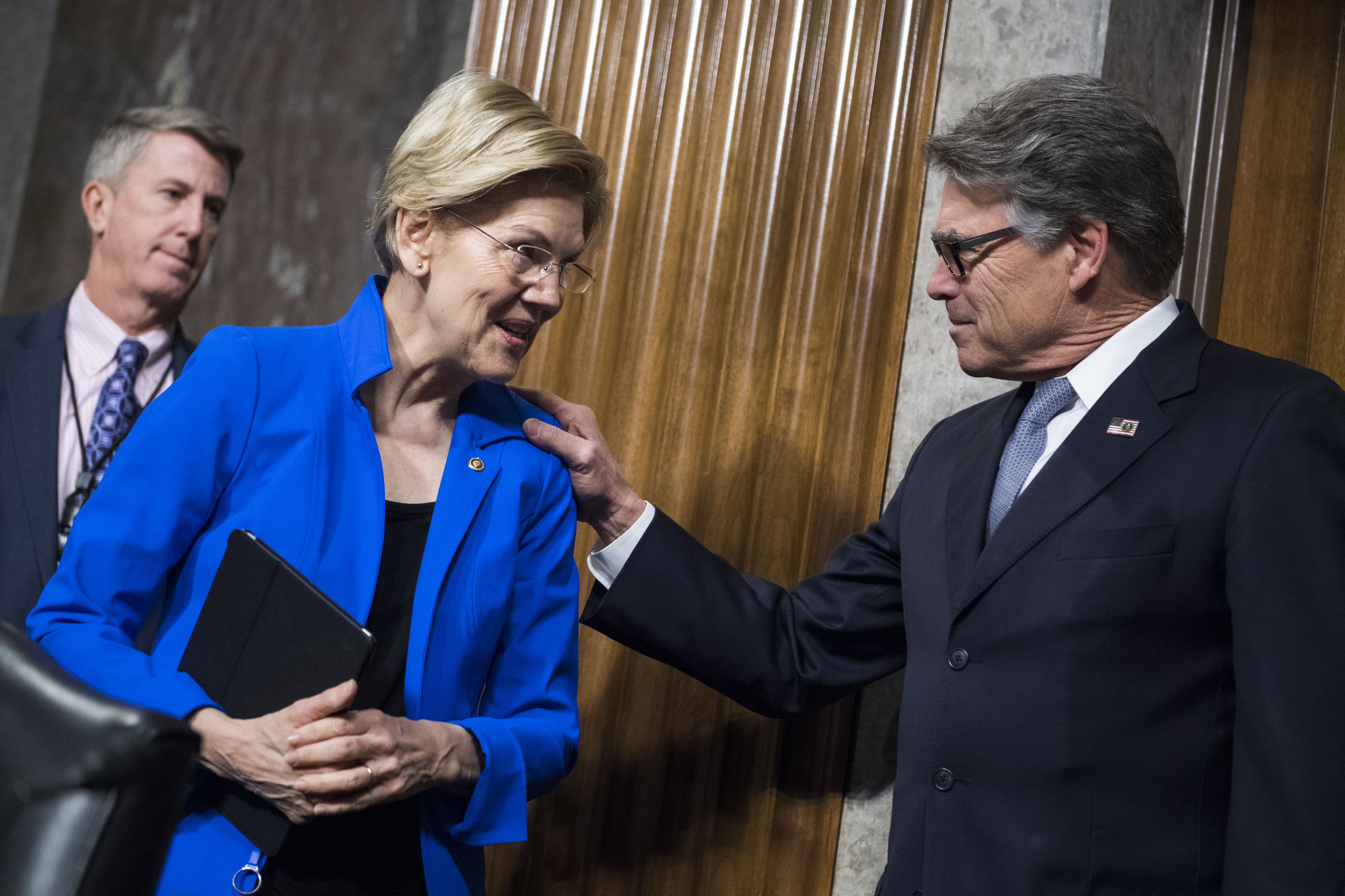 "UNITED STATES - MARCH 28: Energy Secretary Rick Perry greets Sen. Elizabeth Warren, D-Mass, before Senate Armed Committee confirmation hearing titled ""The Department of Energy's Atomic Energy Defense Programs,"" in Dirksen Building on Thursday, March 28, 2019. (Photo By Tom Williams/CQ Roll Call)"