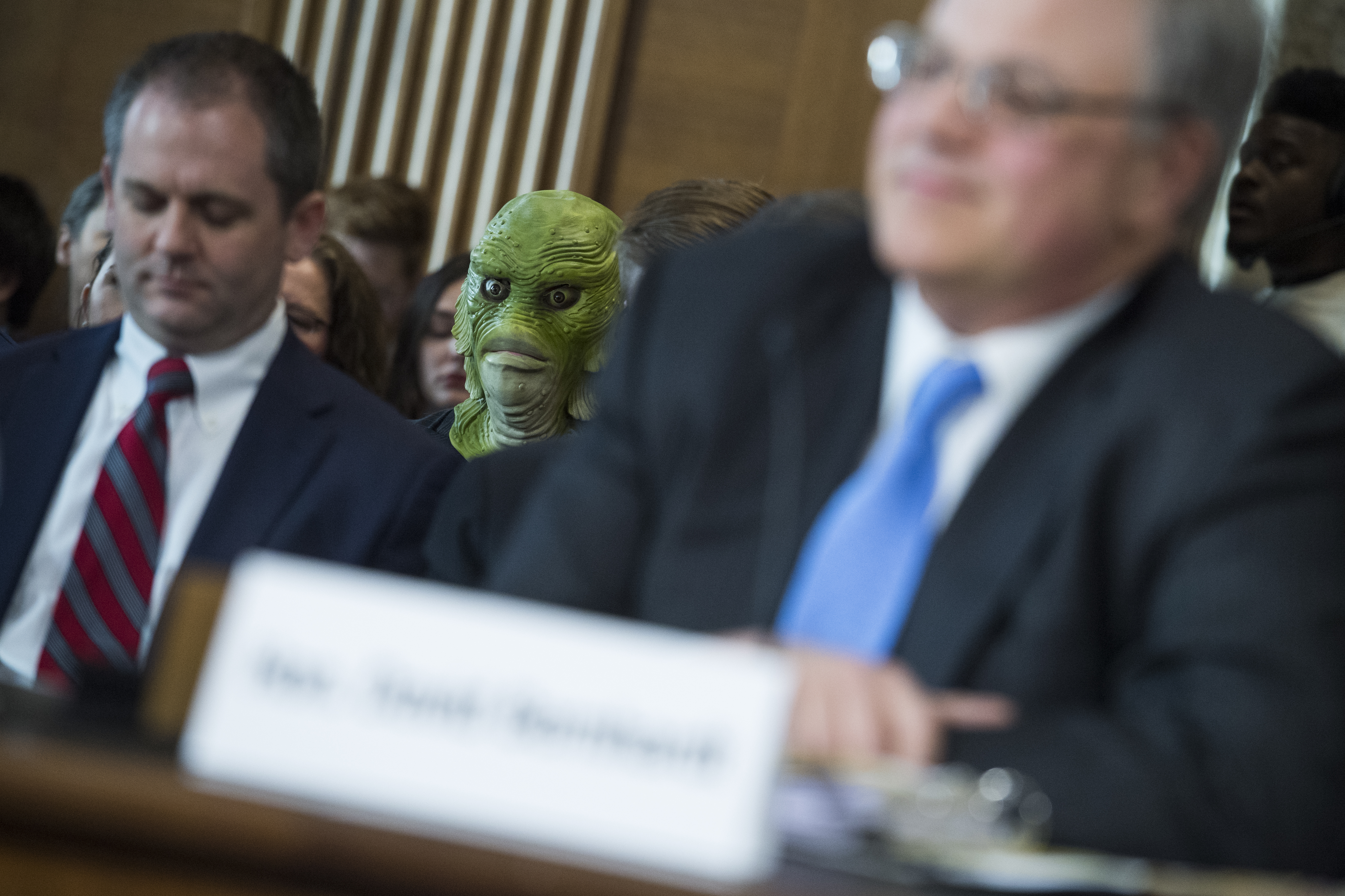 A protester from Clean Water Action is  seen during the during the Senate Energy and Natural Resources confirmation hearing for David Bernhardt, nominee to be Secretary of the Interior, in Dirksen Building on Thursday, March 28, 2019. (Tom Williams/CQ Roll Call)