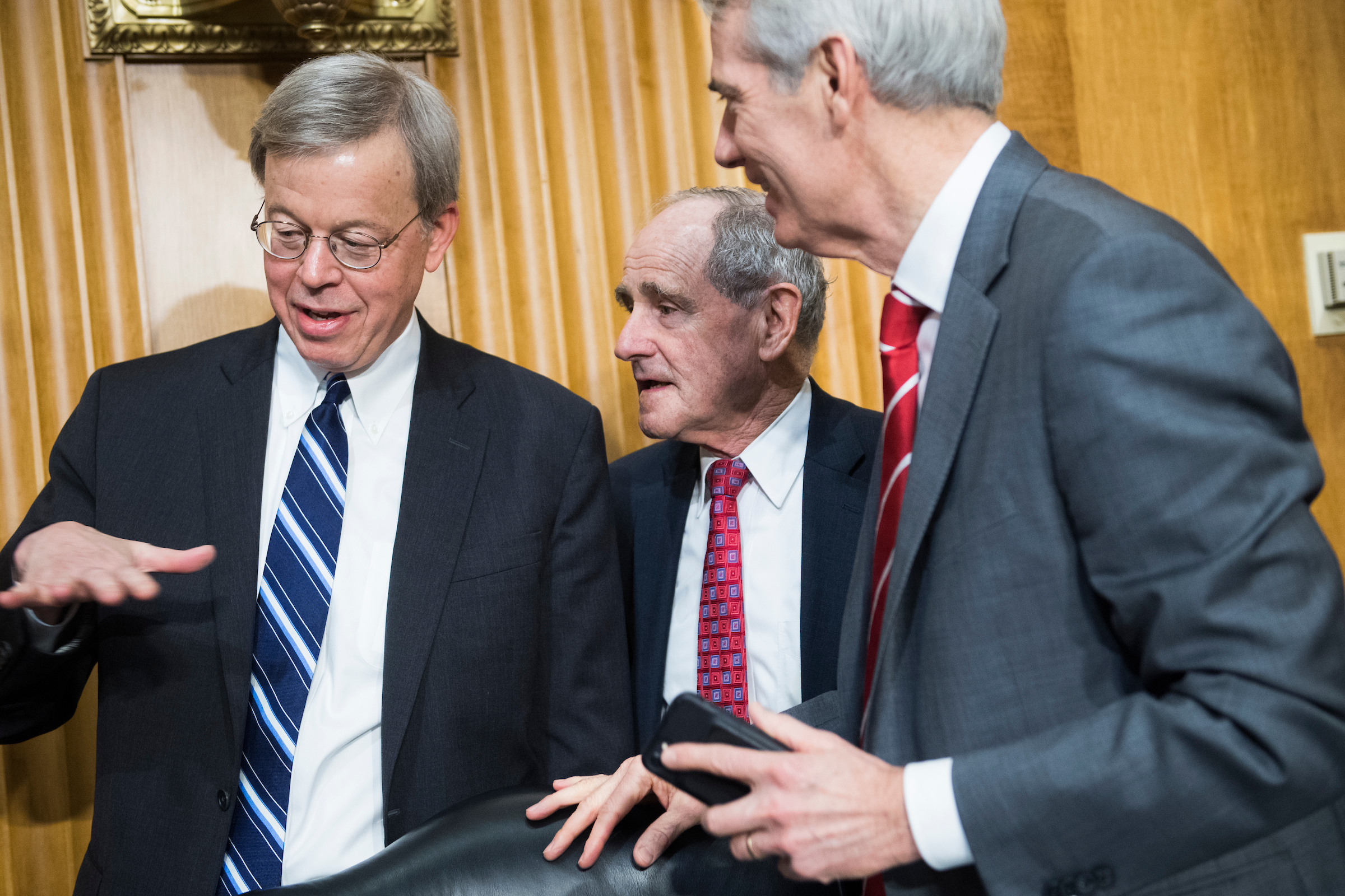 "From left, Jim Talent, commissioner of the U.S.-China Economic and Security Review Commission, Chairman James Risch, R-Idaho, and Sen. Rob Portman, R-Ohio, arrive for a Senate Foreign Relations Committee in Dirksen Building titled ""A New Approach for an Era of U.S.-China Competition,"" on Wednesday, March 13, 2019. (Photo By Tom Williams/CQ Roll Call)"