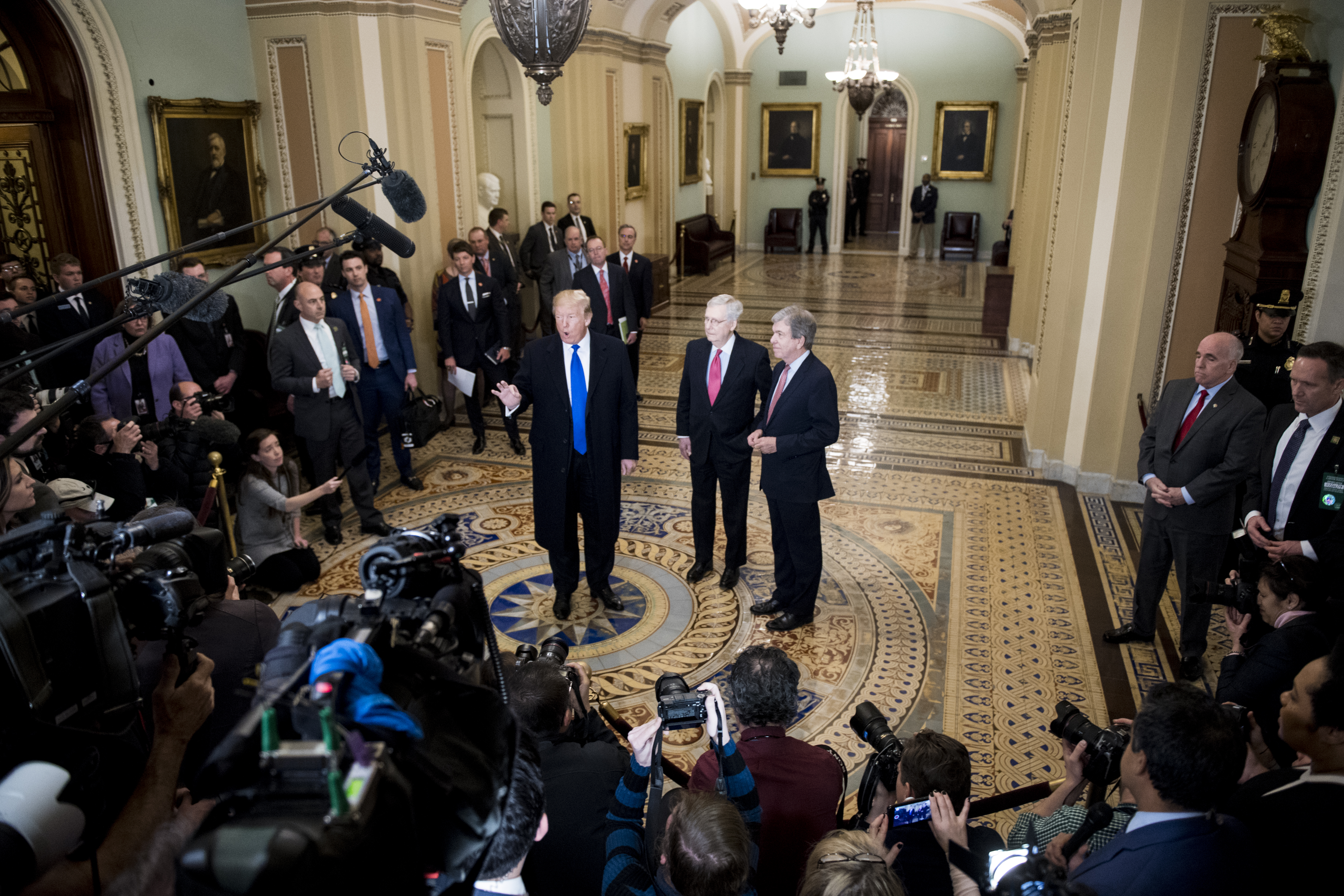 UNITED STATES - MARCH 26: President Donald Trump takes questions from reporters he arrives with Senate Majority Leader Mitch McConnell, R-Ky., center, and Sen. Roy Blunt, R-Mo., right, for the Senate Republicans' lunch in the Capitol on Tuesday, March 26, 2019. (Photo By Bill Clark/CQ Roll Call)