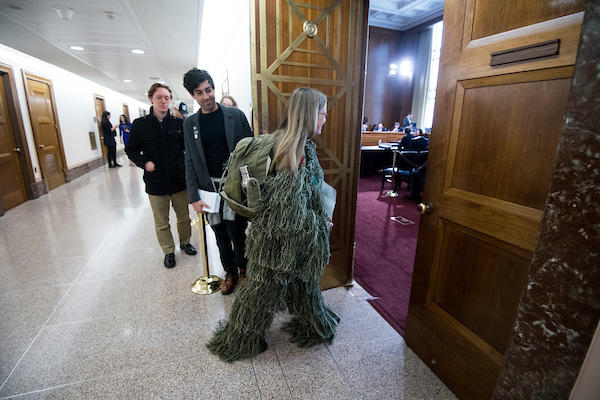 "UNITED STATES - APRIL 4: Clean Water Fund's ""Swamp Creature"" returns to the Senate for the Energy and Natural Resources Committee markup of David Bernhardt's nomination to be Secretary of the Interior on Thursday, April 4, 2019. The group is protesting Bernhardt's ties to the oil and gas industry. (Photo By Bill Clark/CQ Roll Call)"