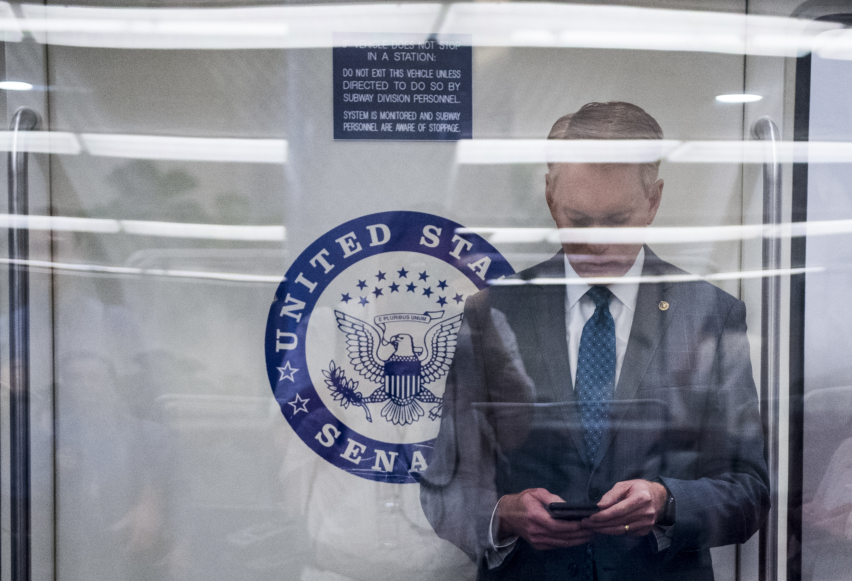 UNITED STATES - MAY 7: Sen. James Lankford, R-Okla., arrives via the Senate subway in the Capitol for the weekly Senate Republican policy lunch on Tuesday, May 7, 2019. (Photo By Bill Clark/CQ Roll Call)