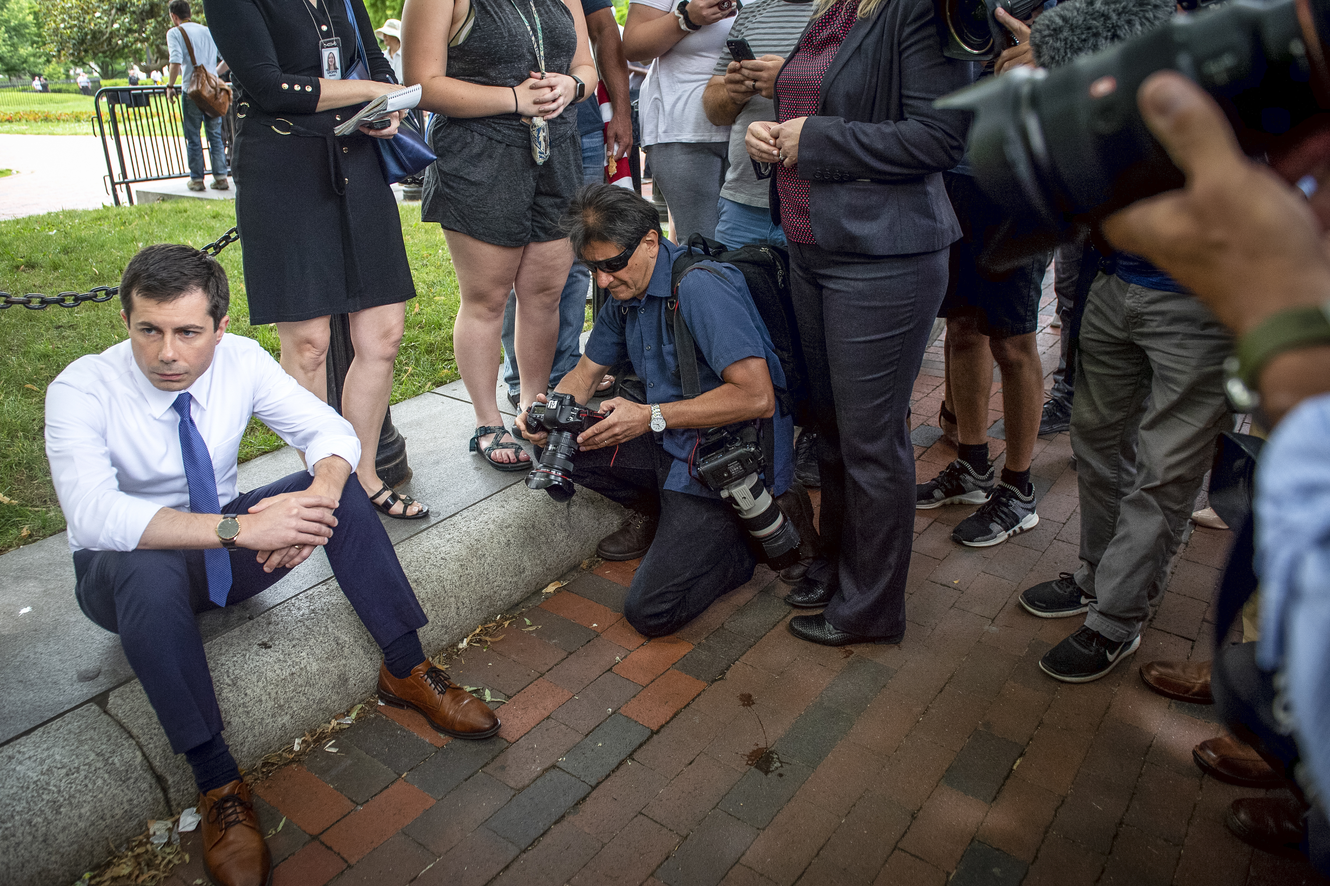 UNITED STATES - JUNE 12: Democratic presidential candidate Mayor Pete Buttigieg sits down to wait before he attends a rally protesting against President Donald Trump policies outside of the White House in Washington on Wednesday June 12, 2019. (Photo by Caroline Brehman/CQ Roll Call)