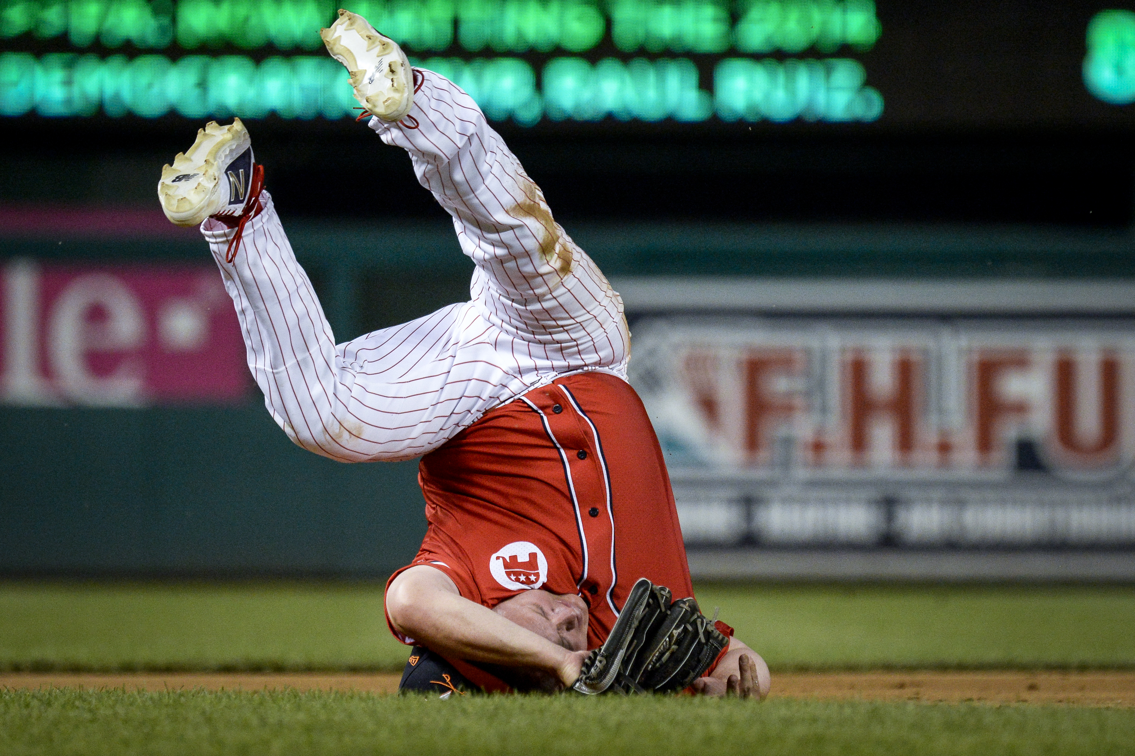 UNITED STATES - JUNE 26: Rep. Denver Riggleman, R-Va., rolls over on his head as he field a ground ball during the 58th annual Congressional Baseball Game at Nationals Park on Wednesday June 26, 2019. (Photo by Caroline Brehman/CQ Roll Call)