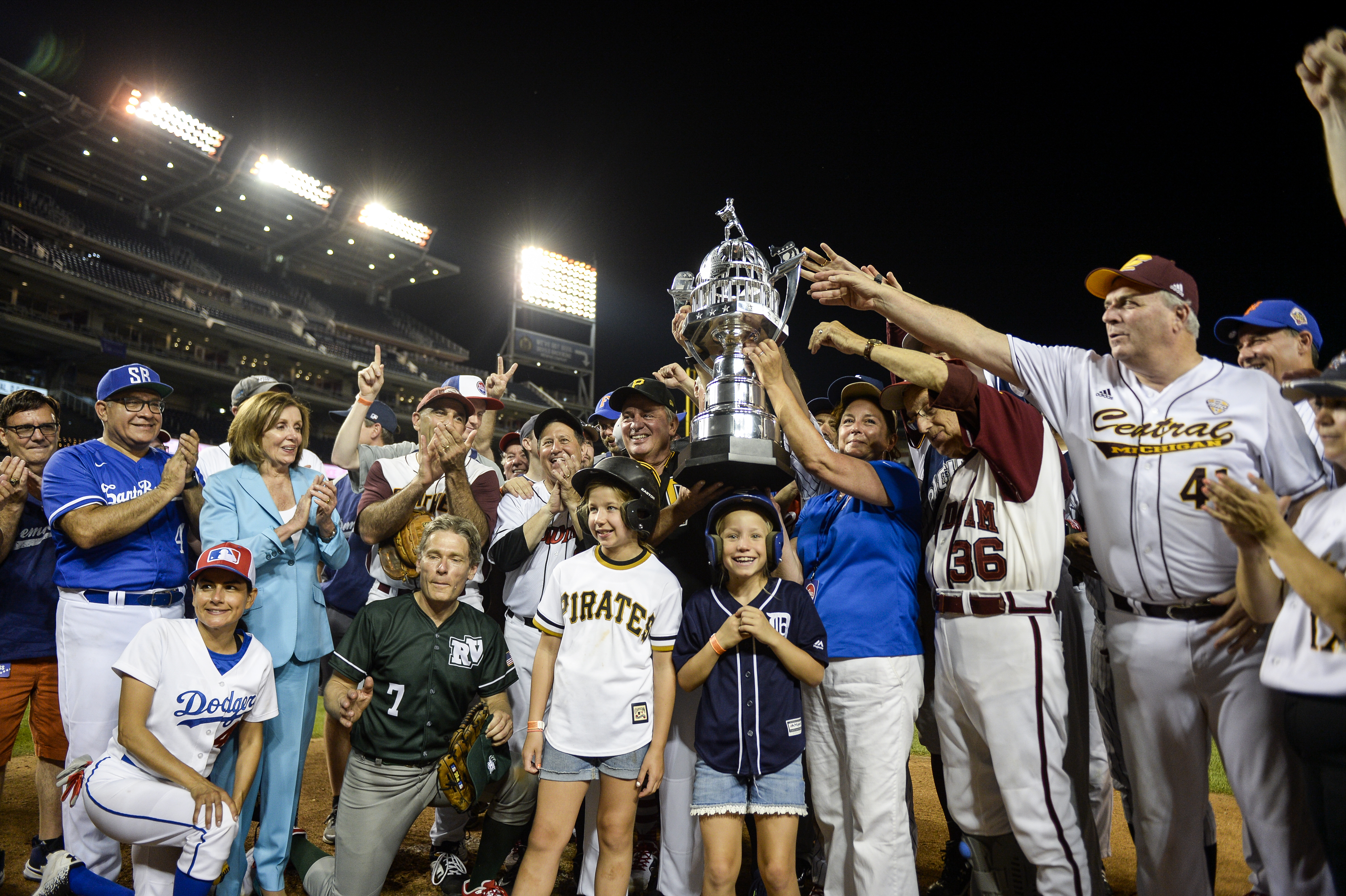 UNITED STATES - JUNE 26: The Democrats stand with their trophy after their 14-7 win over the Republicans in the 58th annual Congressional Baseball Game at Nationals Park on Wednesday June 26, 2019. (Photo by Caroline Brehman/CQ Roll Call)