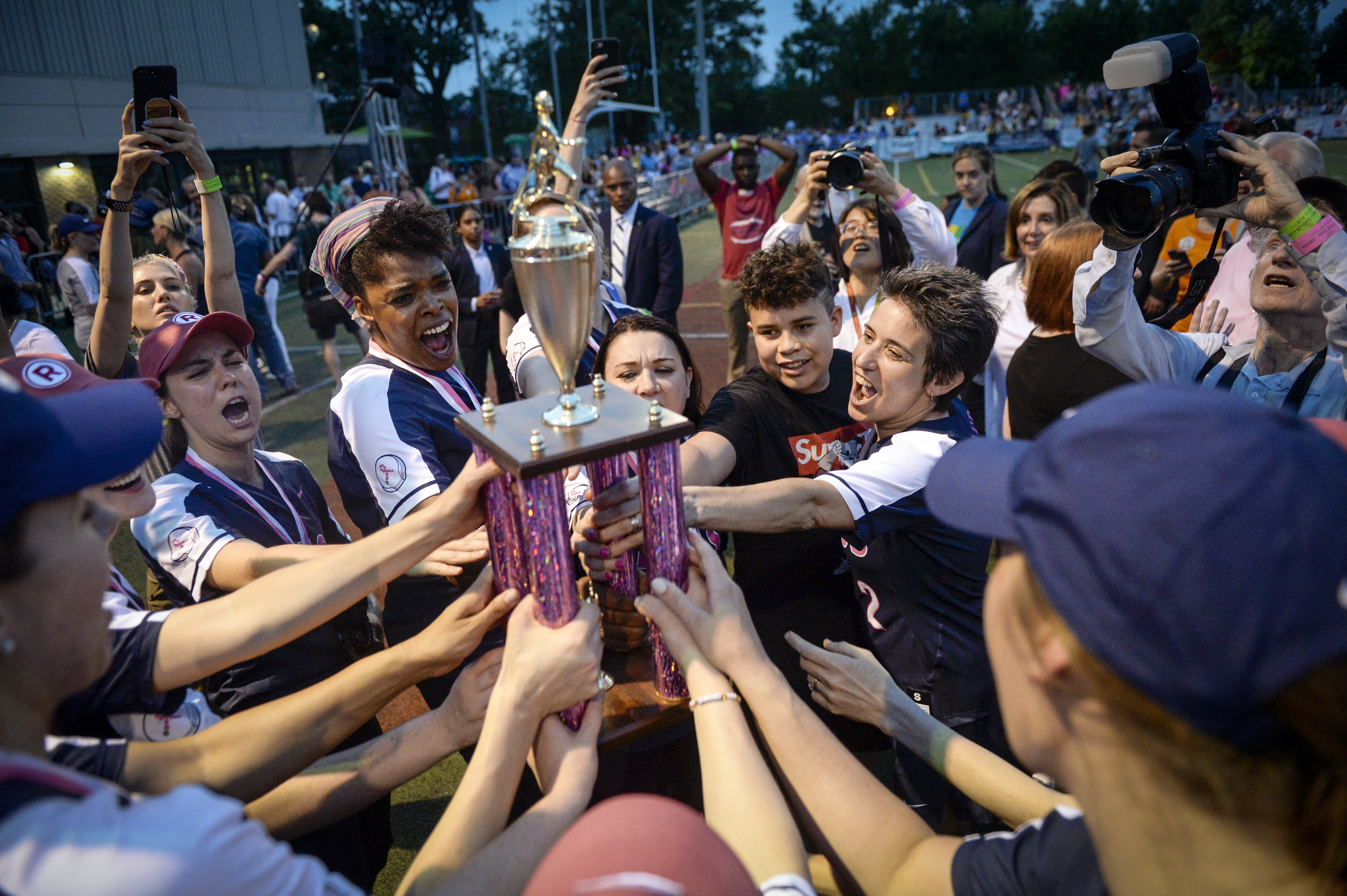 UNITED STATES - JUNE 19: The press softball team holds up a trophy after winning against the Congressional softball team in the in the Congressional Women's Softball Game at Watkins Elementary in Washington on Wednesday June 19, 2019. (Photo by Caroline Brehman/CQ Roll Call)