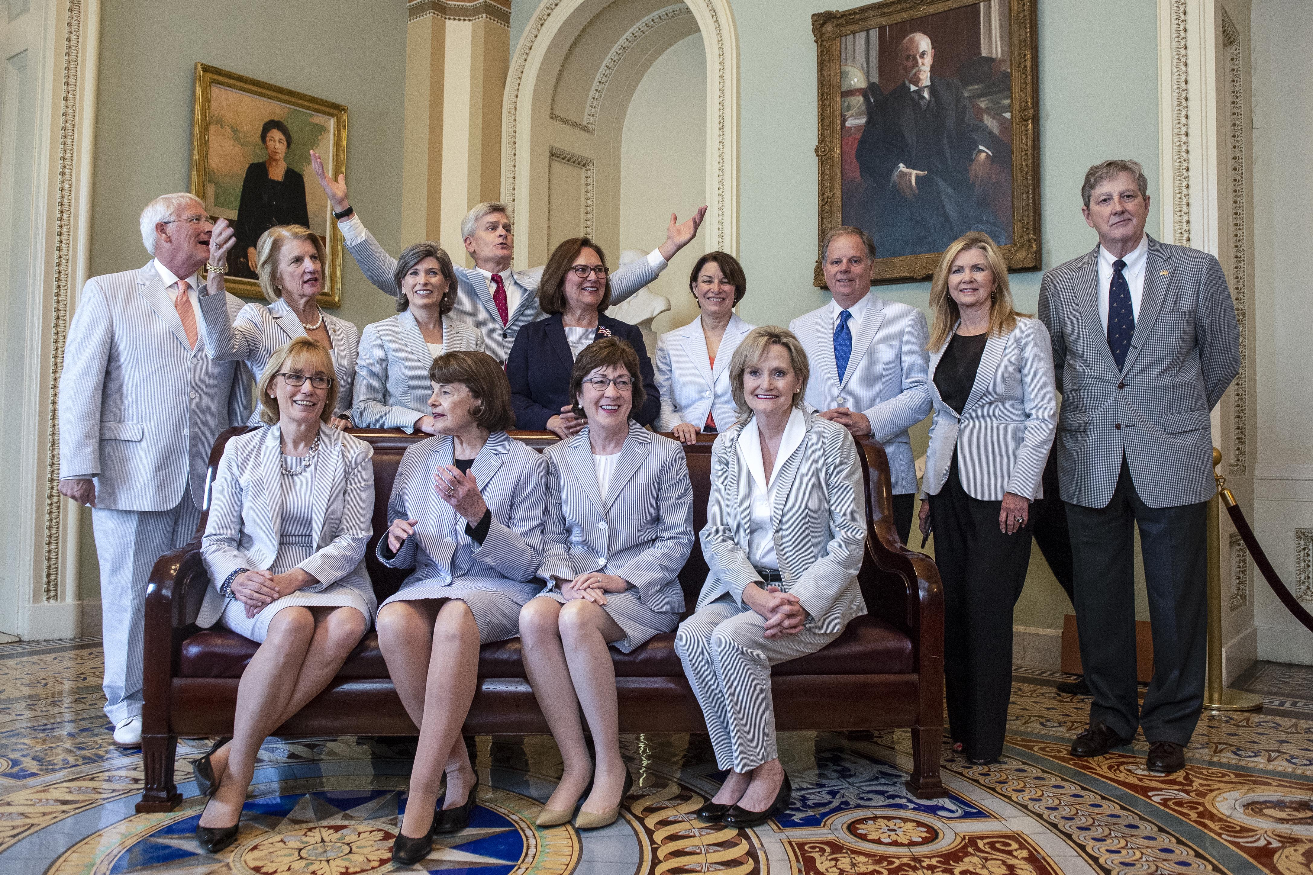 UNITED STATES - JUNE 13: Sen. Maggie Hassan, D-N.H., front left, Sen. Dianne Feinstein, D-Calf., Sen. Susan Collins, R-Maine, Sen. Cindy Hyde-Smith, R-Miss., Sen. Roger Wicker, R-Miss., back left, Sen. Shelley Moore Capito, R-W.Va., Sen. Joni Ernst, R-Iowa, Sen. Bill Cassidy, R-La., Sen. Deb Fischer, R-Neb., Sen. Amy Klobuchar, D-Minn., Sen. Doug Jones, D-Ala., R-N.C., Sen. Marsha Blackburn, R-Tenn., and Sen. John Kennedy, R-La., come together to celebrate National Seersucker Day in Washington on Thursday June 13, 2019. (Photo by Caroline Brehman/CQ Roll Call)