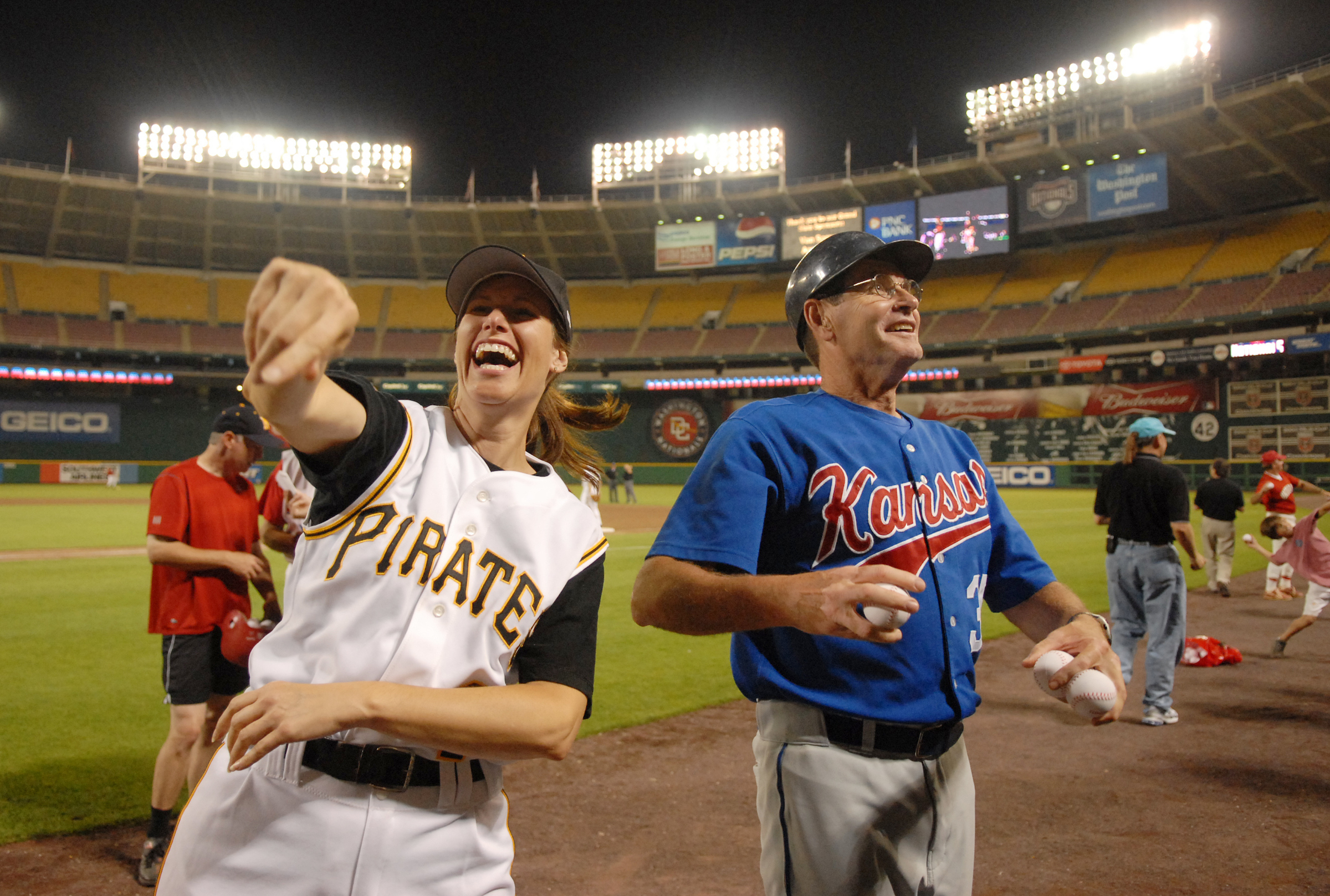 Rep. Melissa Hart, R-Pa., and Jim Ryun, R-Kan., throw foam balls to the crowd at the 45th Annual Roll Call Congressional Baseball game played at RFK stadium.
