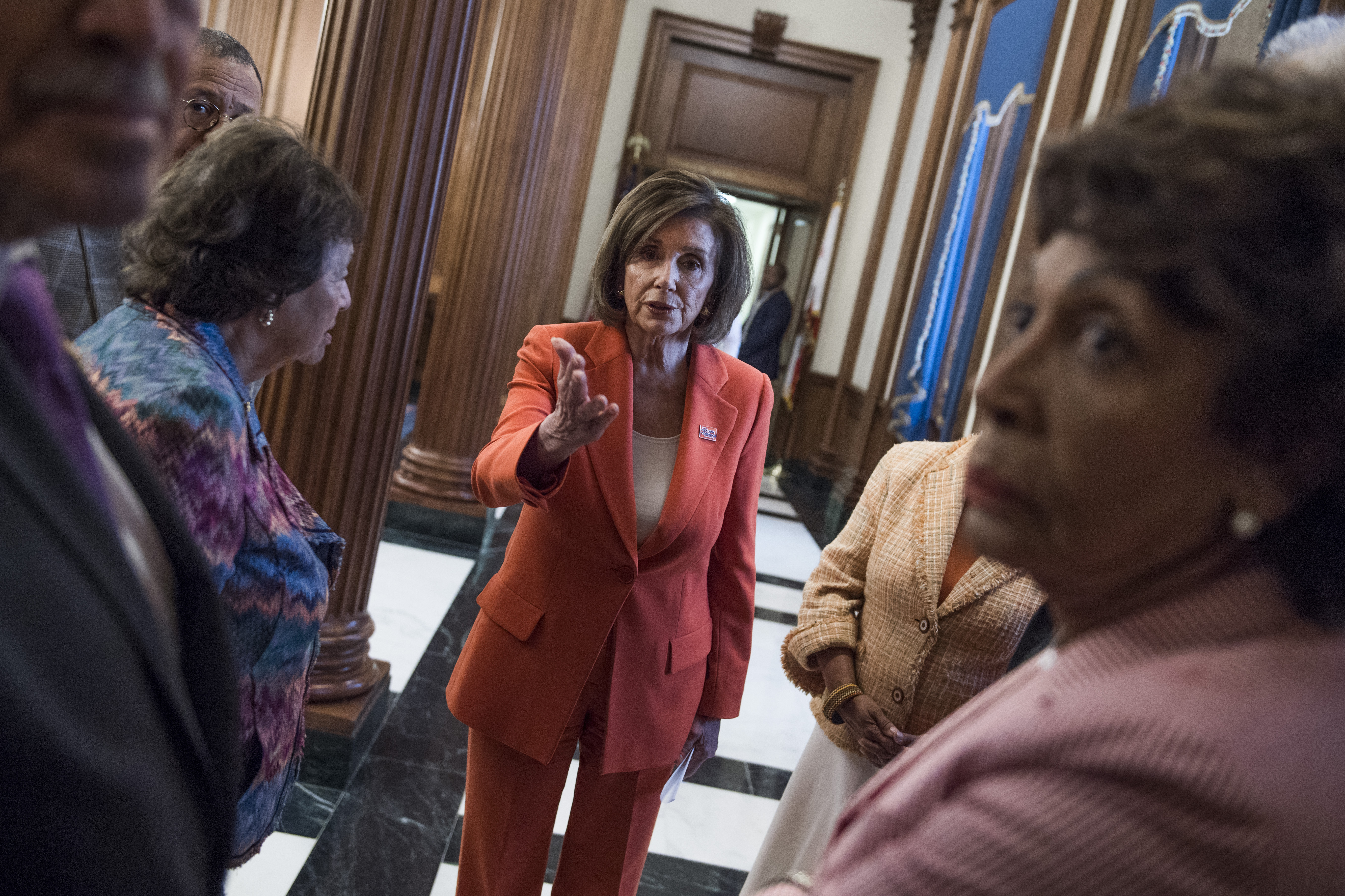 "UNITED STATES - JUNE 5: Speaker Nancy Pelosi, D-Calif., talks with members in the Capitol before a bill signing for the ""Additional Supplemental Appropriations for Disaster Relief Act, 2019,"" on Wednesday, June 5, 2019. (Photo By Tom Williams/CQ Roll Call)"