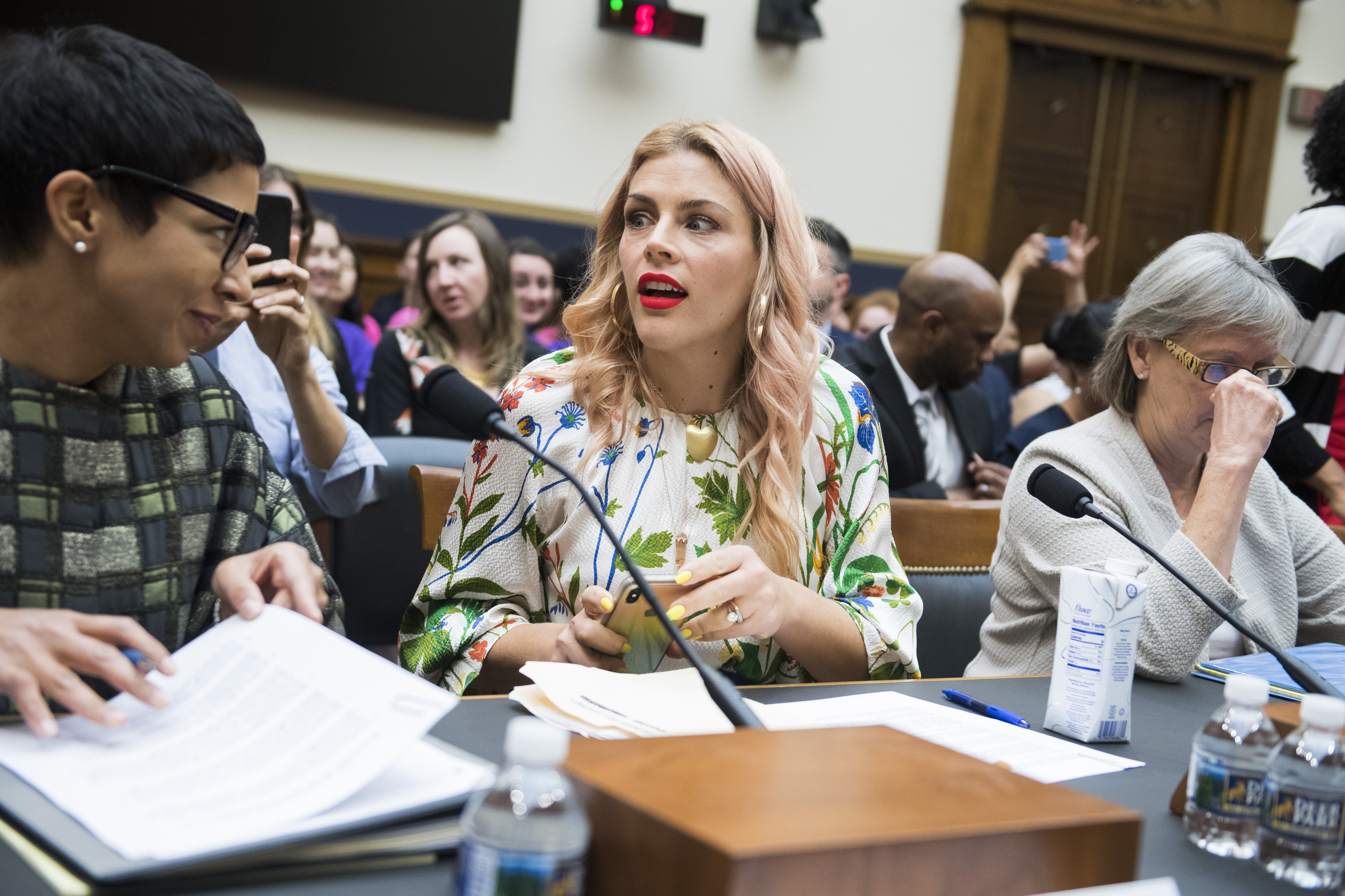 "UNITED STATES - JUNE 4: Actor Busy Philipps, center, and Melissa Murray, professor of law at NYU, prepare to testify during House Judiciary Subcommittee on Constitution, Civil Rights and Civil Liberties hearing titled ""Threats to Reproductive Rights in America,"" on Tuesday, June 4, 2019. Philipps talked about her decision to have an abortion at age 15. (Photo By Tom Williams/CQ Roll Call)"