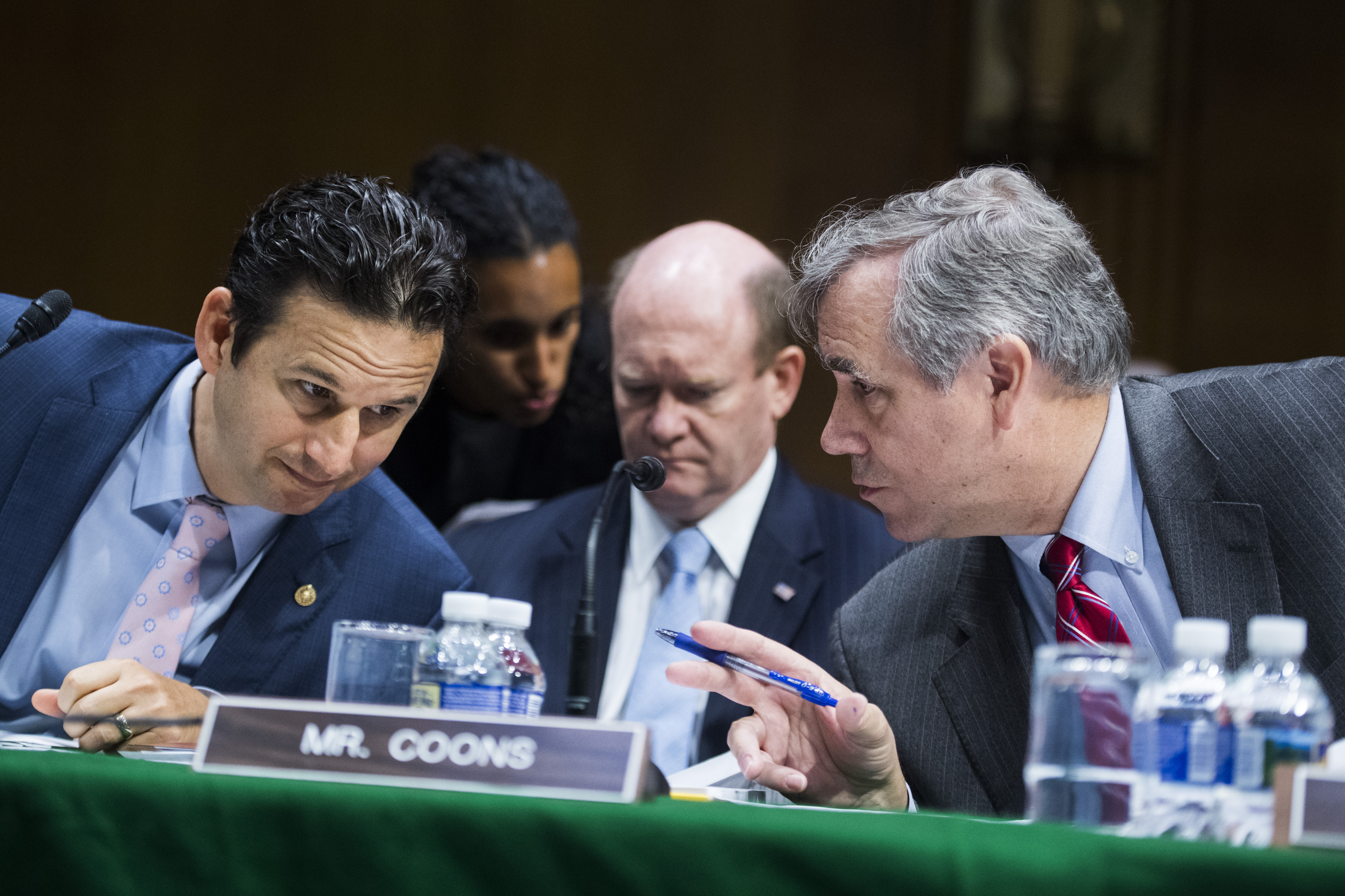 UNITED STATES - JUNE 19: From left, Sens. Brian Schatz, D-Hawaii, Chris Coons, D-Del., and Jeff Merkley, D-Ore., prepare for a Senate Appropriations Committee markup of the Emergency Supplemental Appropriations for Humanitarian Assistance and Security at the Southern Border Act, on Wednesday, June 19, 2019. (Photo By Tom Williams/CQ Roll Call)