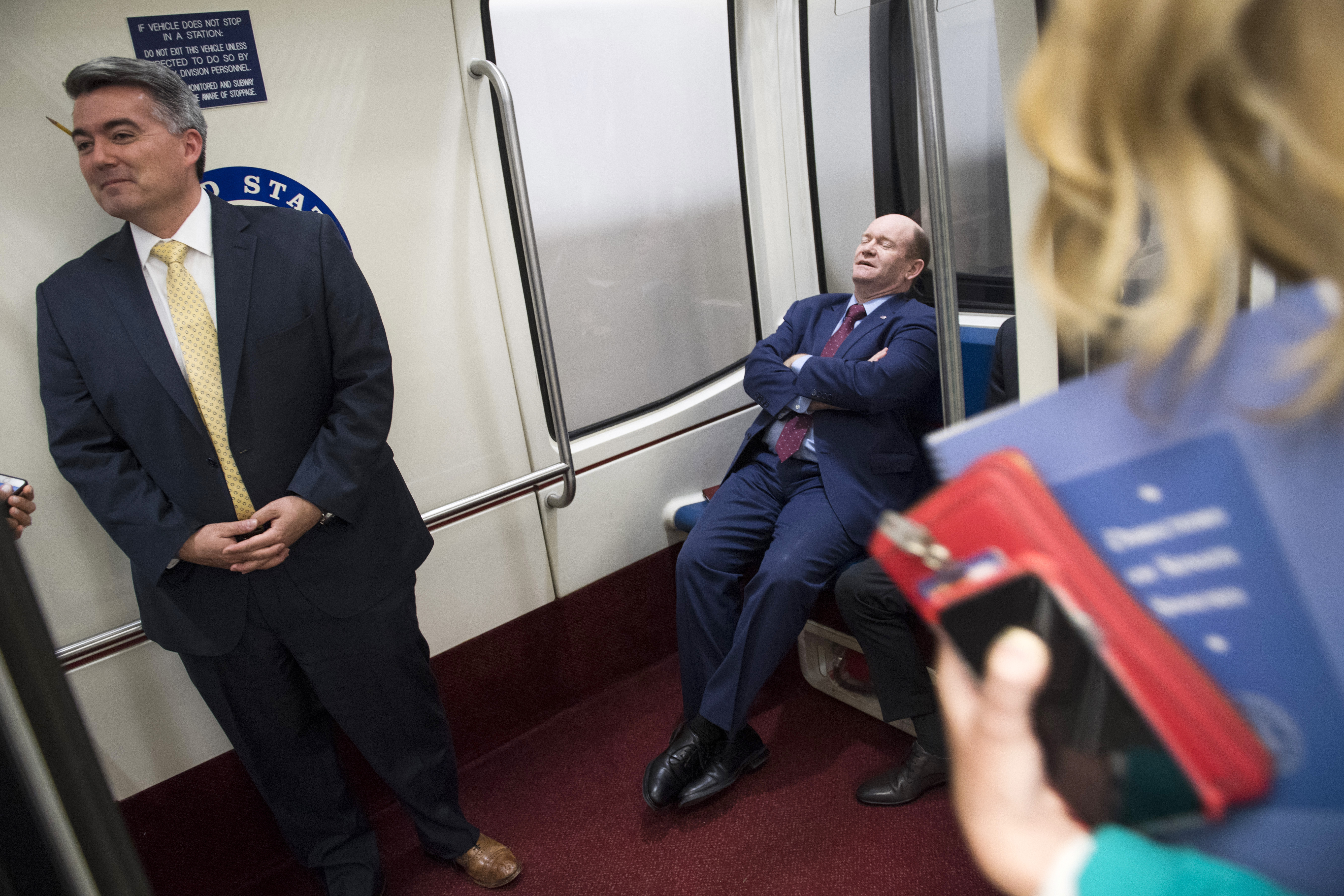 UNITED STATES - JUNE 5: Sens. Chris Coons, D-Del., right, and Cory Gardner, R-Colo., board the senate subway after a vote in the Capitol on Wednesday, June 5, 2019. (Photo By Tom Williams/CQ Roll Call)
