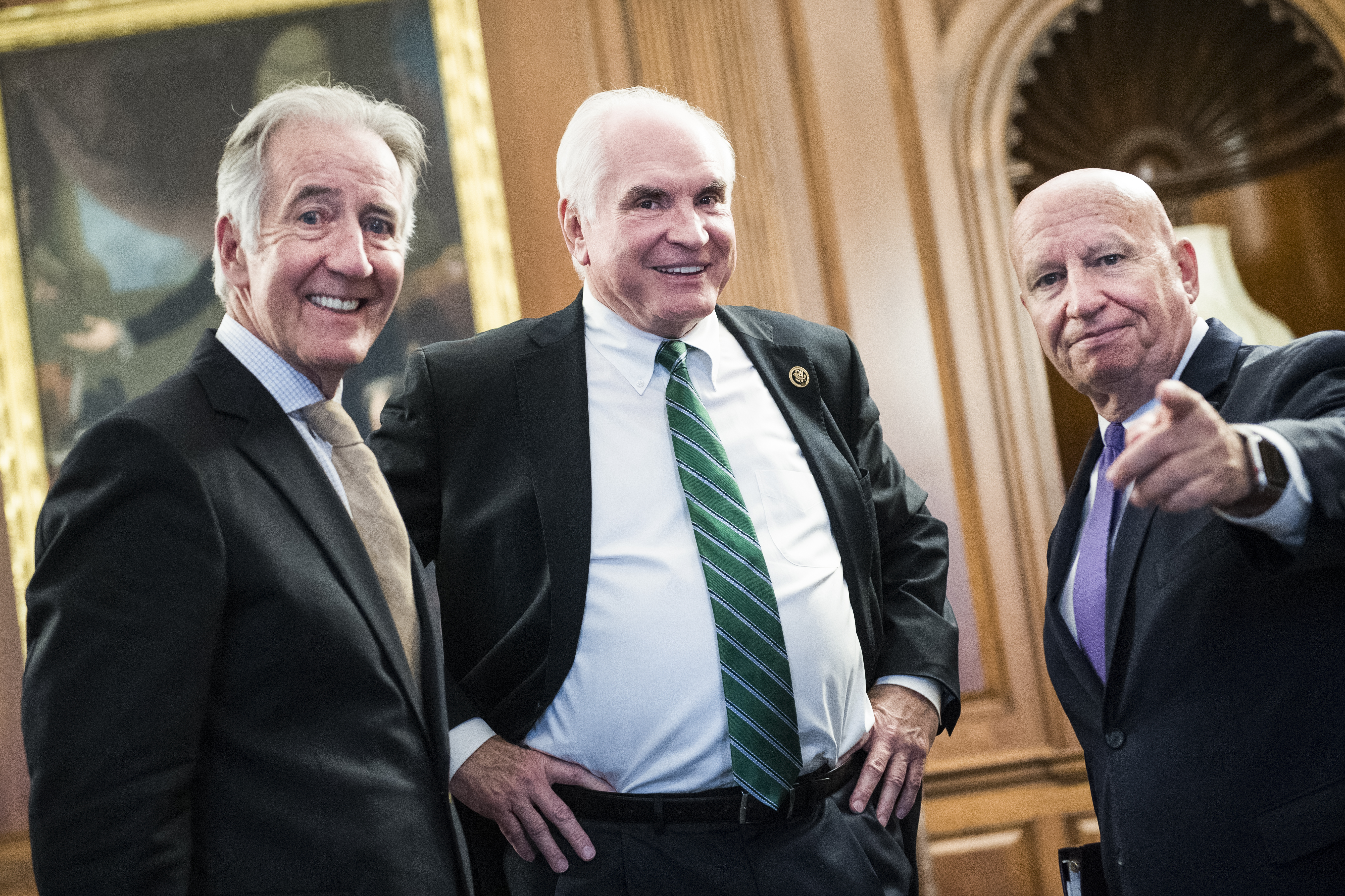 UNITED STATES - JUNE 21: From left, Ways and Means Chairman Richard Neal, D-Mass., Rep. Mike Kelly, R-Pa., and ranking member Kevin Brady, R-Texas, are seen in the Capitol's Rayburn Room before a bill enrollment for the Taxpayer First Act on Friday, June 21, 2019. (Photo By Tom Williams/CQ Roll Call)