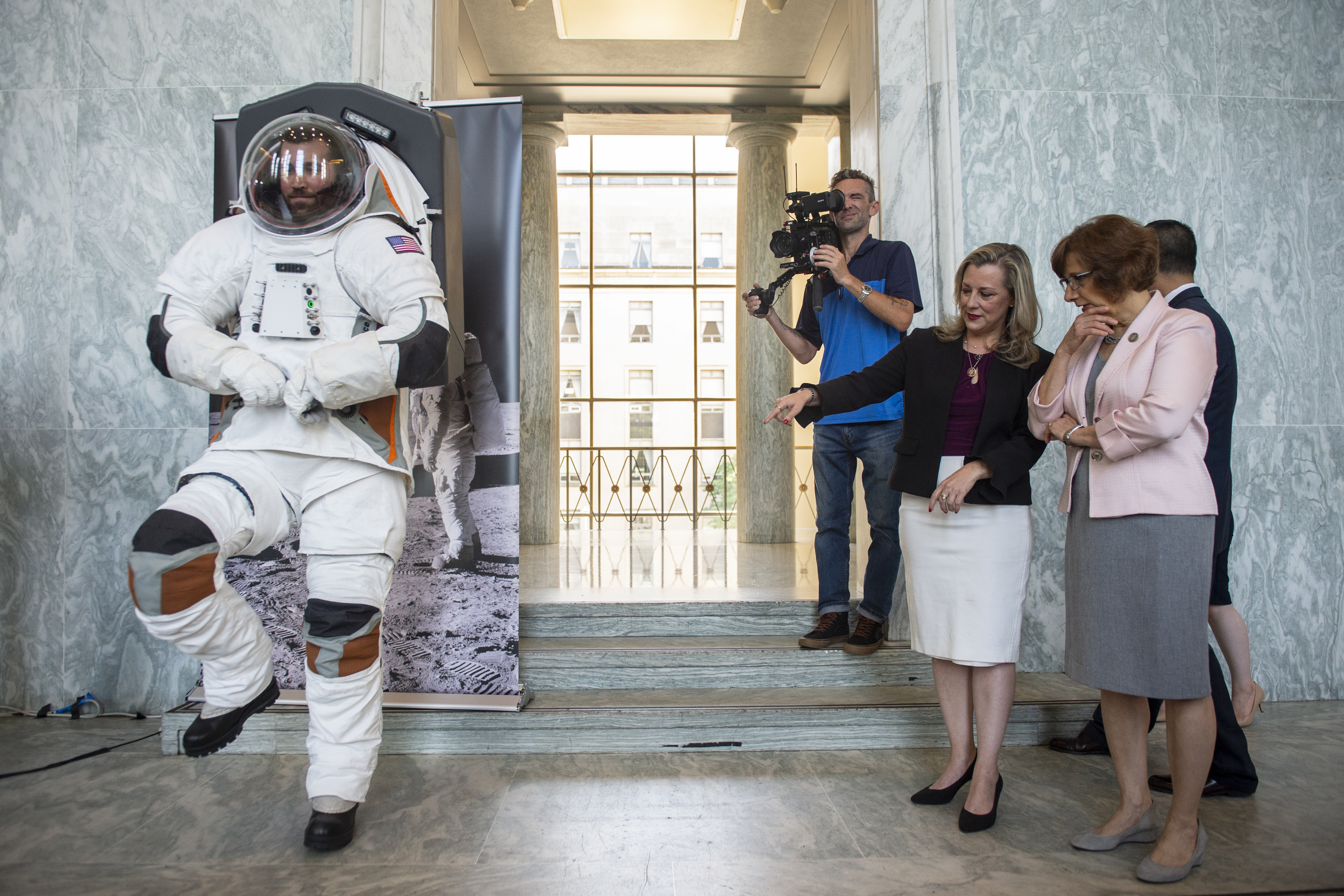 Rep. Suzanne Bonamici, D-Ore., right, and Space Subcommittee Chair Rep. Kendra Horn, D-Okla., look at a man modeling a possible prototype of the future suit for the upcoming mission to the moon in the Rayburn Building in Washington on Thursday July 25, 2019. (Photo by Caroline Brehman/CQ Roll Call)