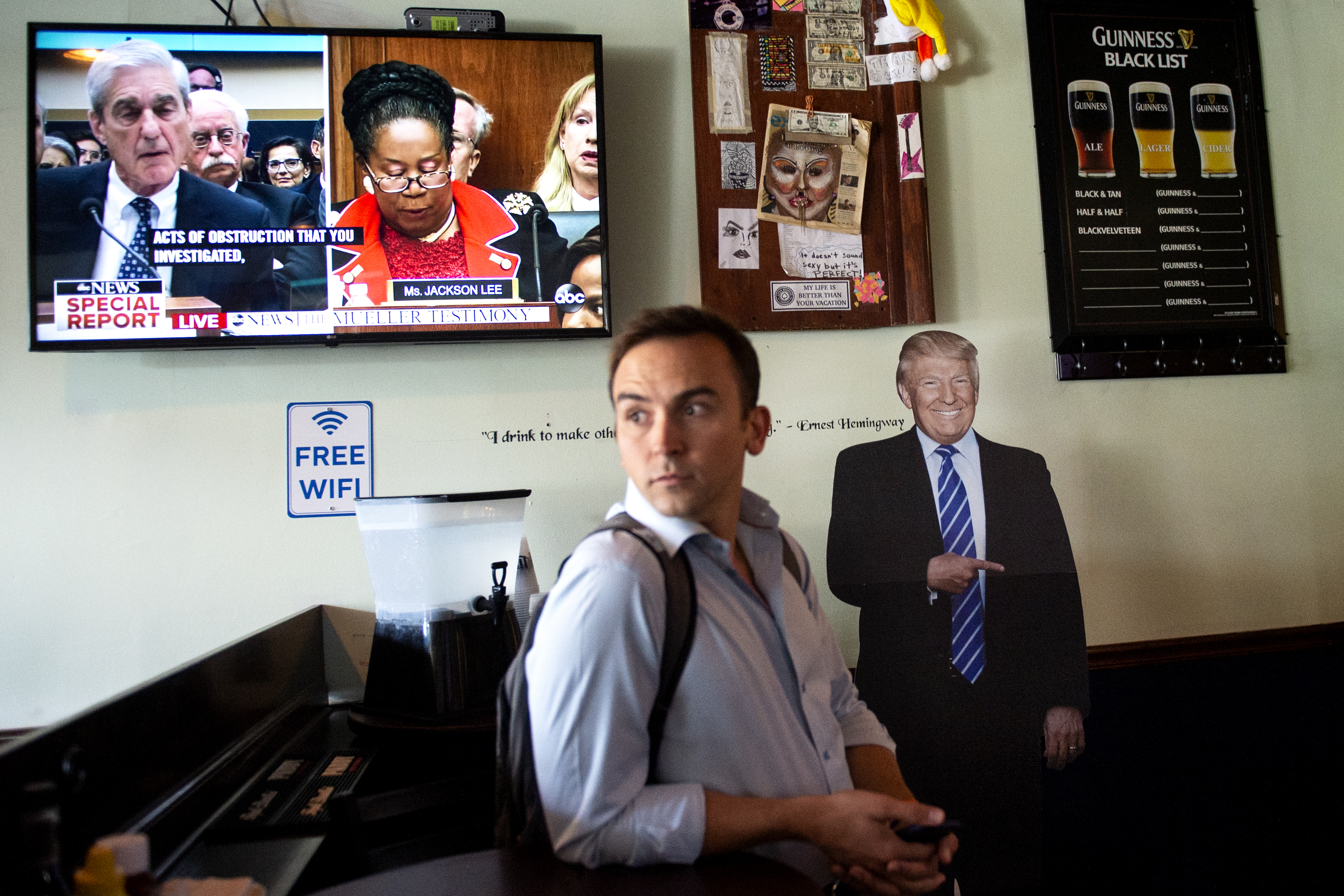 UNITED STATES - JULY 24: A man watches former special counsel Robert Mueller testify before the House Judiciary Committee as it is shown at Duffy's Irish Pub in Washington on Wednesday July 24, 2019. (Photo by Caroline Brehman/CQ Roll Call)