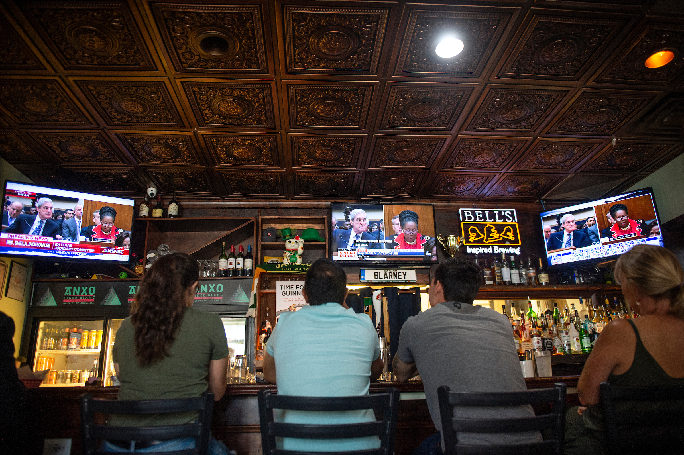 People watch former special counsel Robert Mueller testify before the House Judiciary Committee as it is shown at Duffy's Irish Pub in Washington on Wednesday July 24, 2019. (Photo by Caroline Brehman/CQ Roll Call)