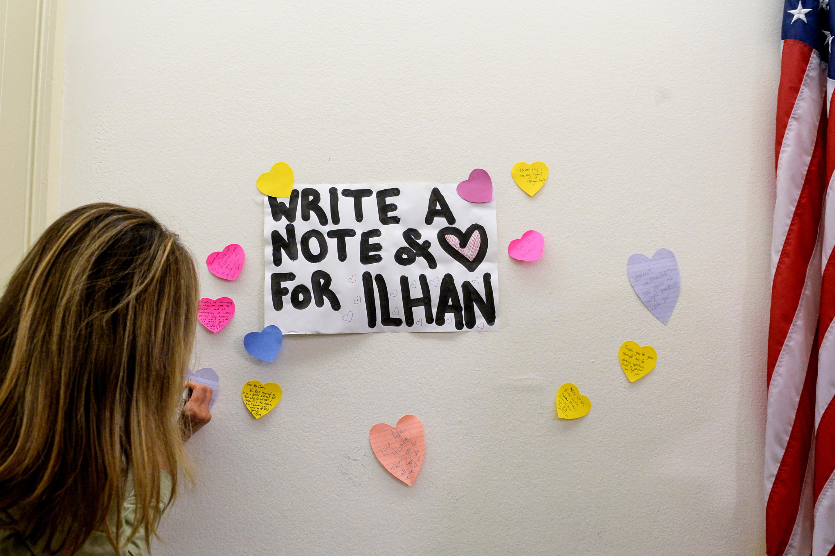 UNITED STATES - JULY 19: A visitor writes an inspiring notes outside of the office of Rep. Ilhan Omar, D-Minn., after attacks from President Trump days before at the Longworth Building at the Capitol on Friday July 19, 2019. (Photo by Caroline Brehman/CQ Roll Call)