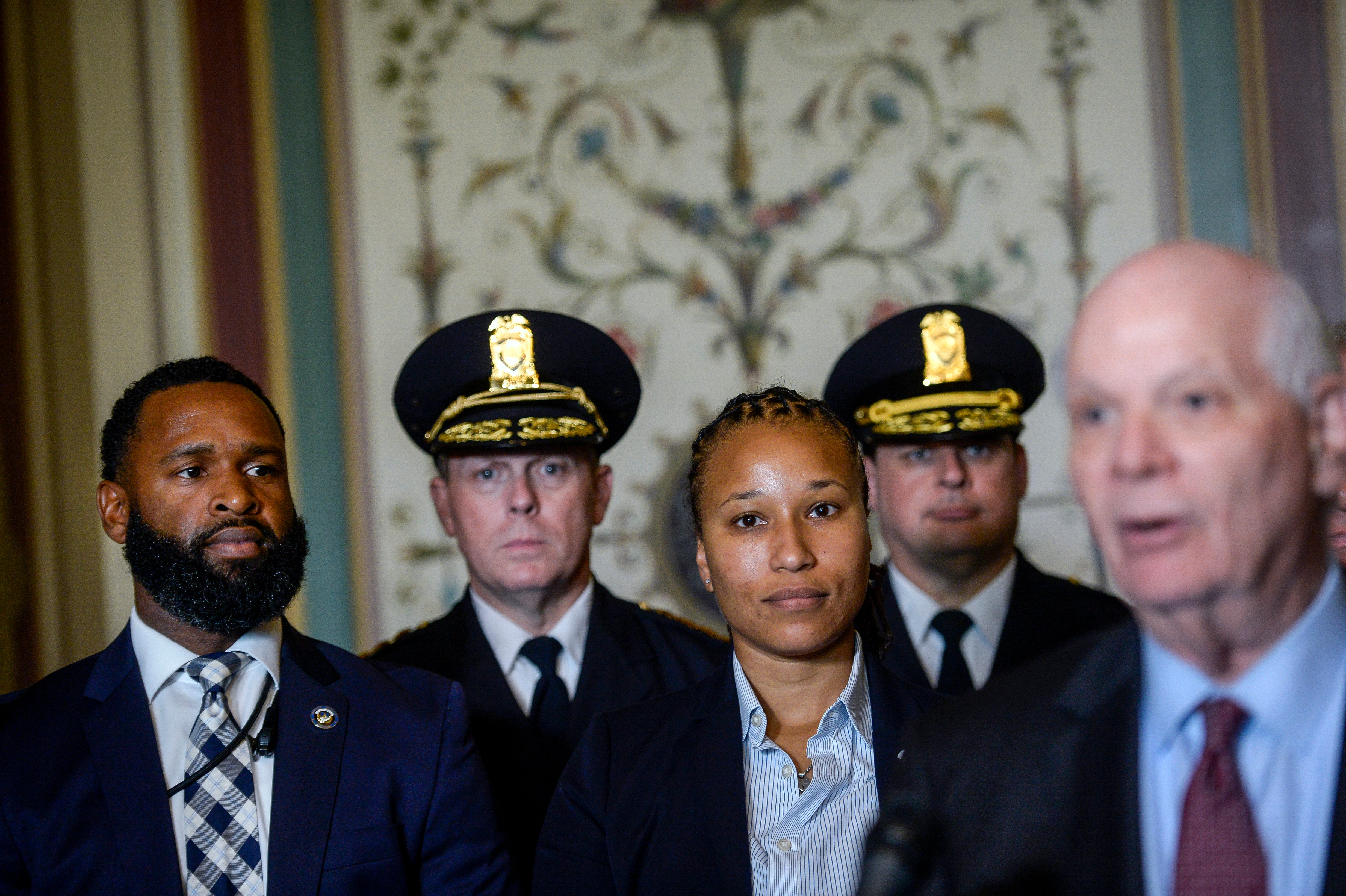 UNITED STATES - JULY 16: U.S. Capitol Police Special Agents David Bailey, left, and Crystal Griner stand as Sen. Ben Cardin, D-Md., presents them with the Law Enforcement Congressional Badge on Capitol Hill on Tuesday July 16, 2019. (Photo by Caroline Brehman/CQ Roll Call)
