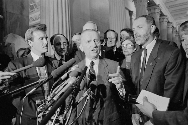 UNITED STATES: Businessman Ross Perot flanked by Republican freshmen members of Congress speaks at a press conference in the U.S. Capitol in May of 1993. (Photo CQ Roll Call File Photo)