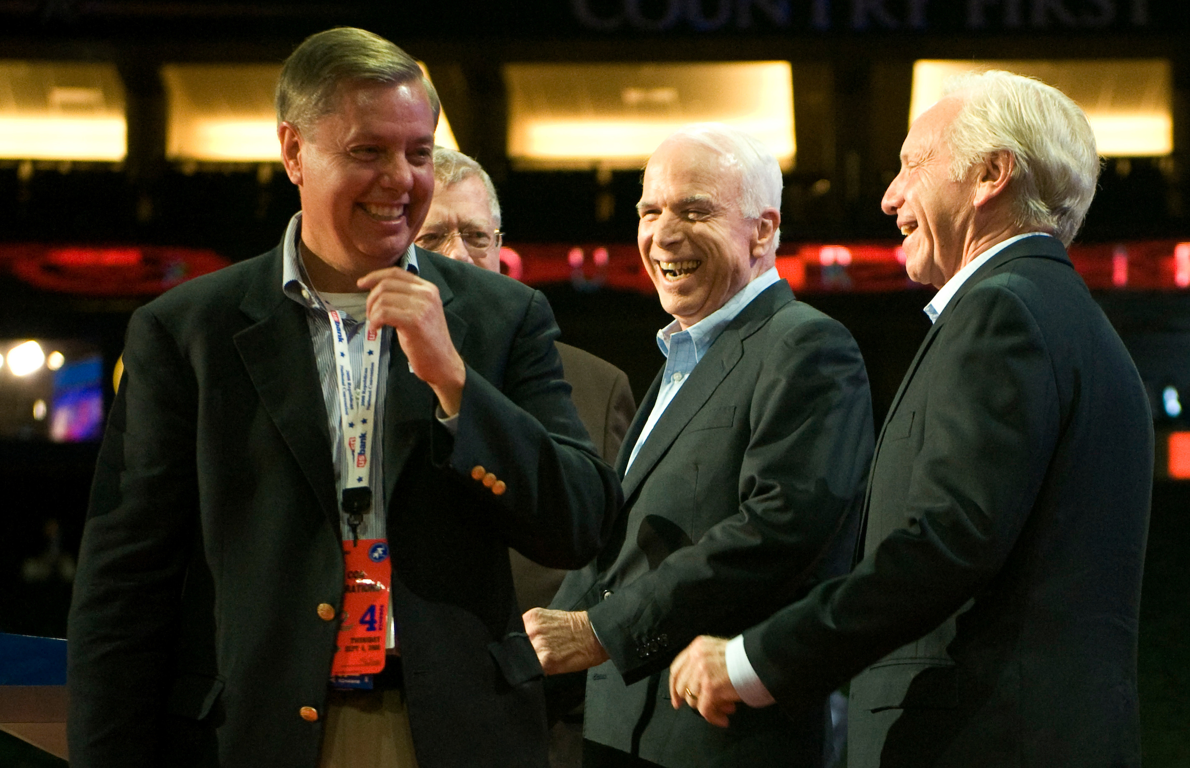 From left, Sen. Lindsey Graham, R-S.C., Republican presidential candidate Sen. John McCain, R-Ariz., and Sen. Joe Lieberman, I-Conn., laugh on stage during McCains stage walk through at the Republican National Convention at the Xcel Center in St. Paul, Minn., on Thursday, Sept. 4, 2008.